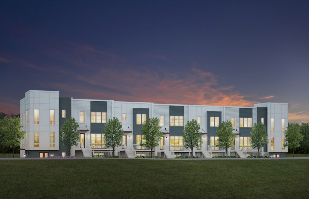 A rendering of white and blue townhomes with a sunset behind them and grass in front.