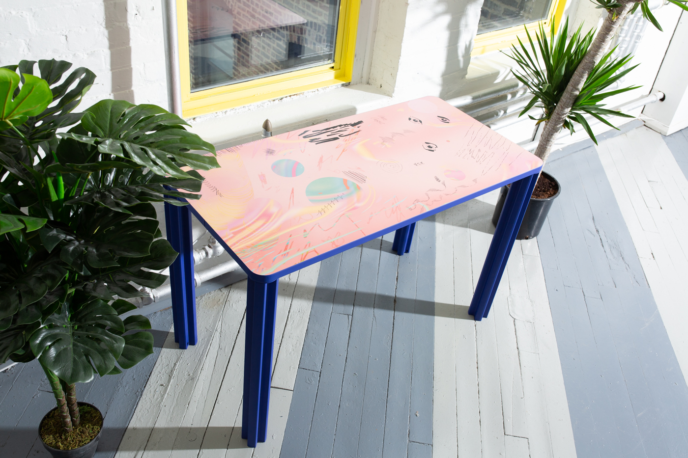 Desk printed with solar system pattern.