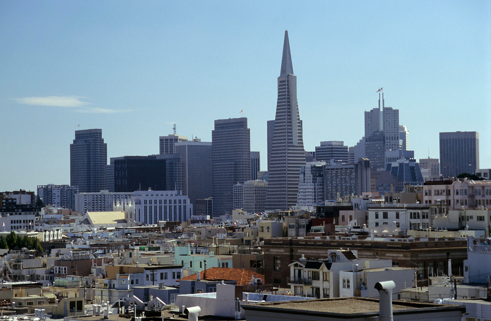 Rows of building in San Francisco, including a tall, pointed one.