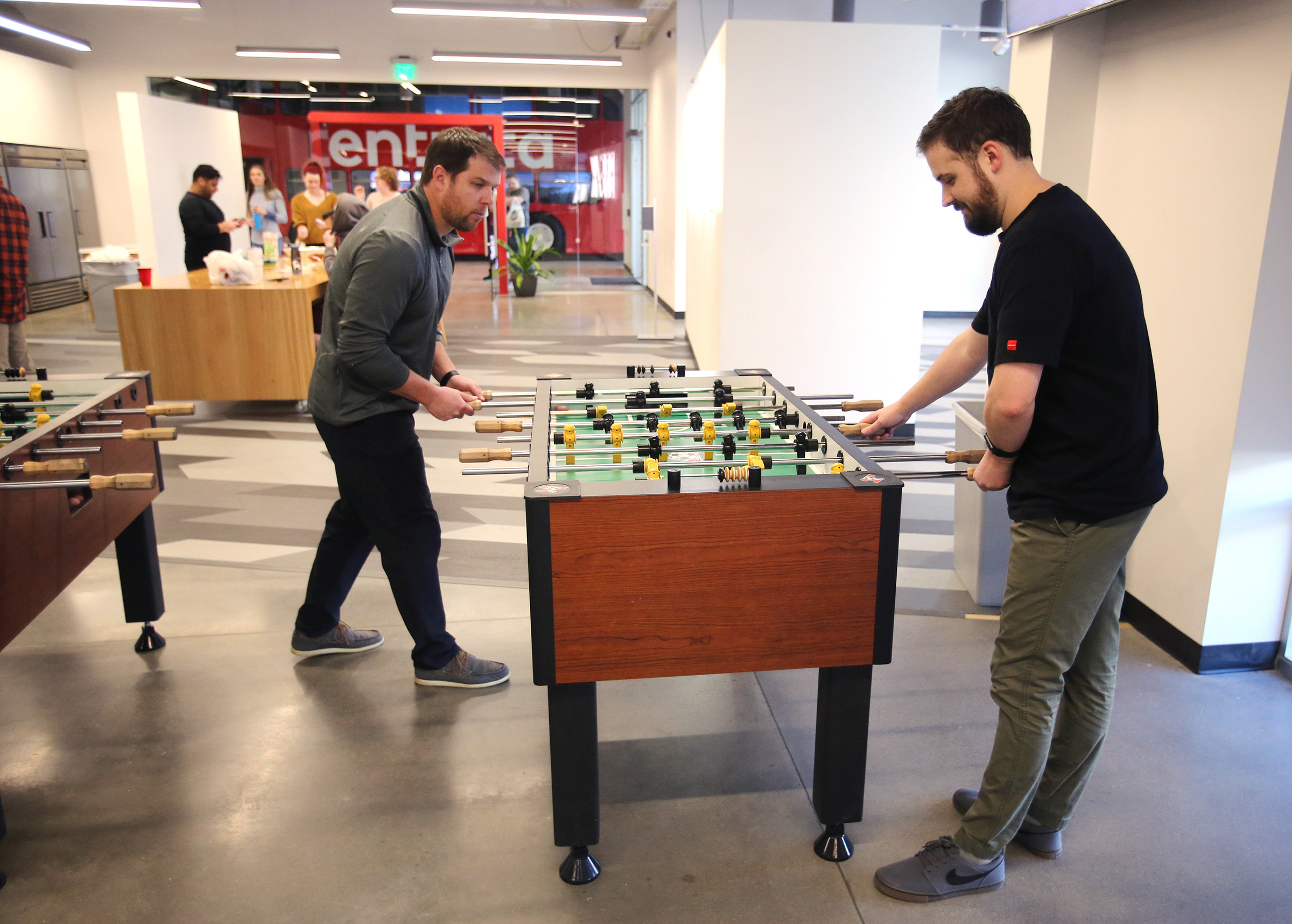 Coby Rich, vice president of marketing at Entrata, and Nate Mathis, public relations manager, play foosball in the company's break/lunch room in the Lehi on Tuesday, Feb. 25, 2020.