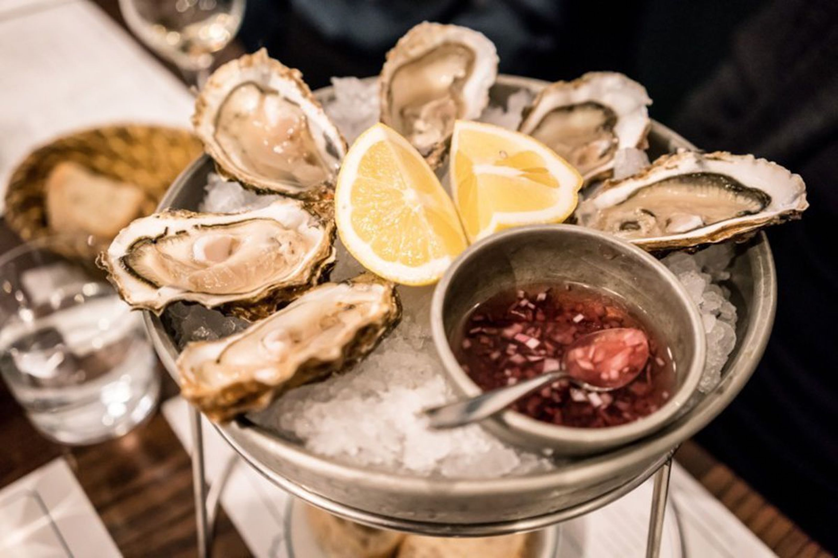 Oysters on ice with mignonette and lemon