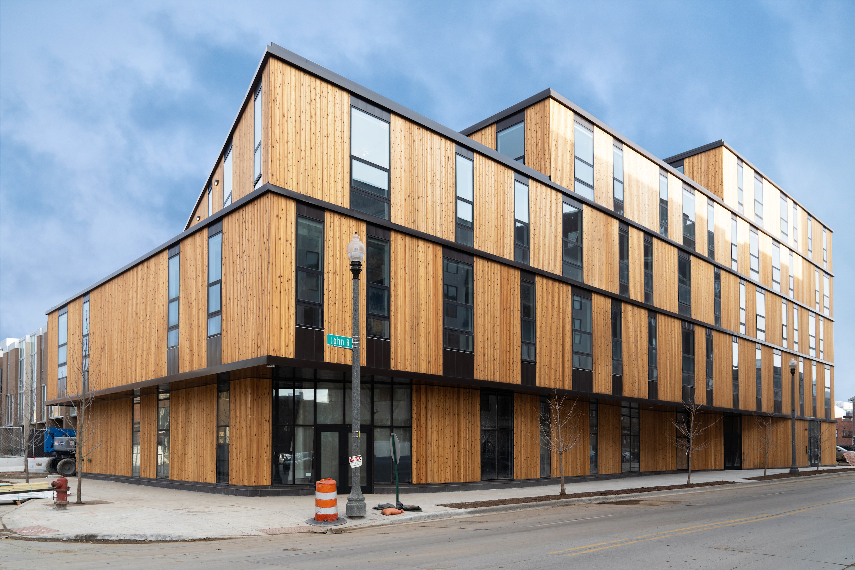 A four-story building with wood-cladding and narrow windows. It's rectangular with each floor slightly smaller.