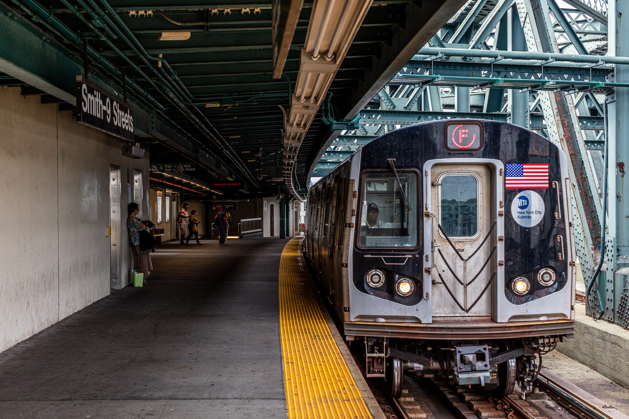 The F train pulls into the Smith-9th Streets station.