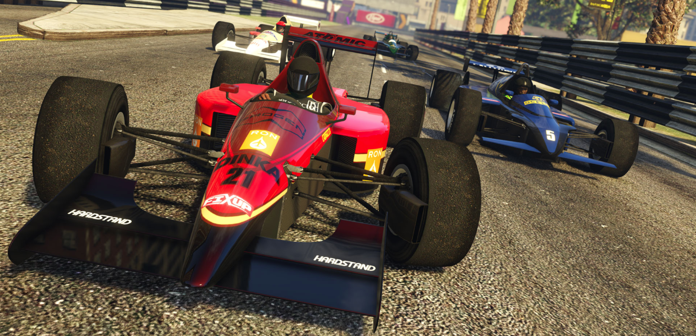 three high-performance race cars zoom into the frame, demonstrating the new Open-Wheel Racing available in Grand Theft Auto Online