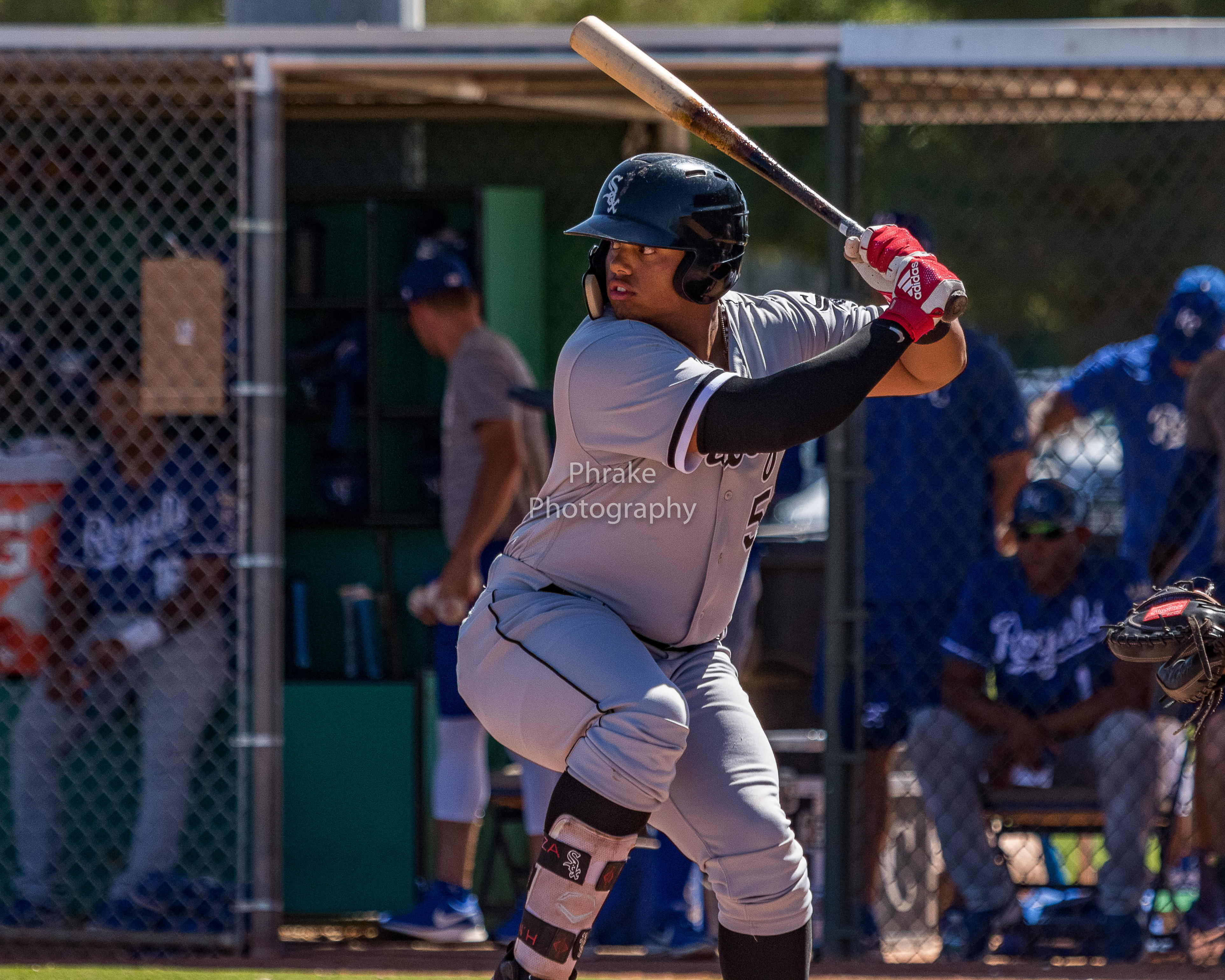 Harvin Mendoza bats lefty, open side with a leg kick