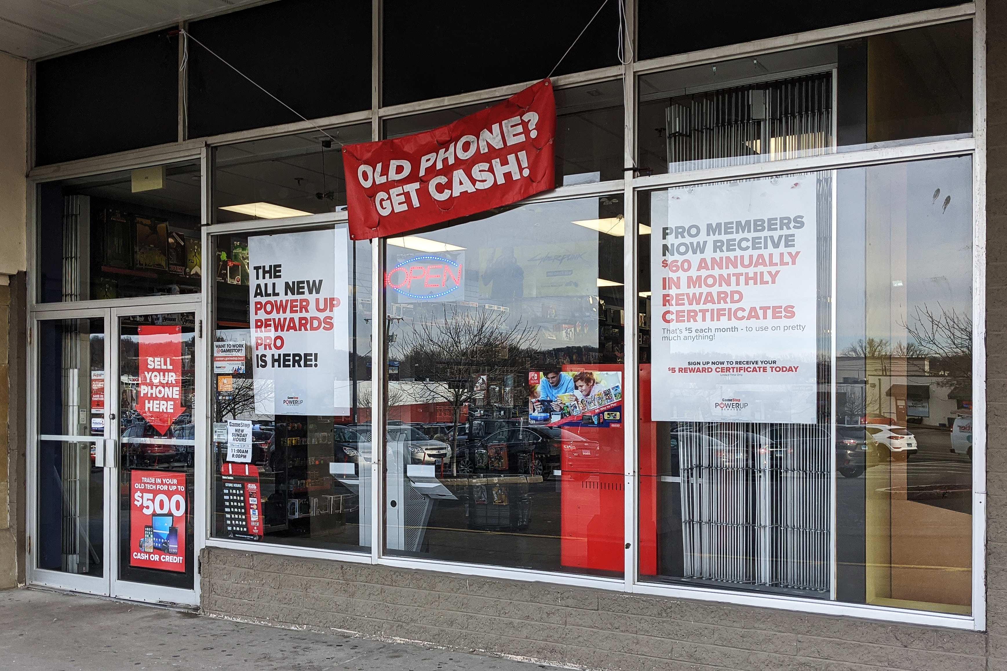 front of GameStop shop featuring numerous promotions