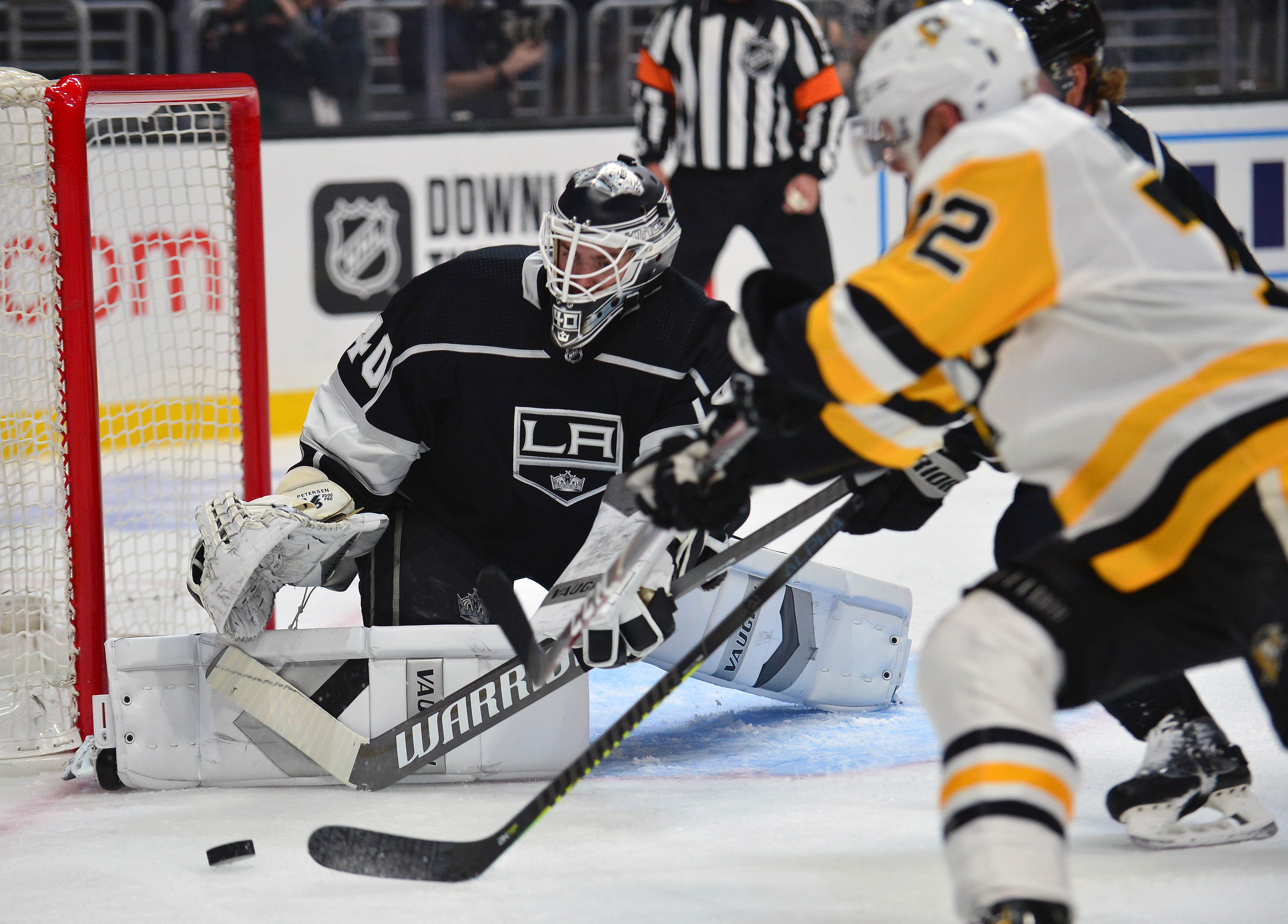 February 26, 2020; Los Angeles, California, USA; Los Angeles Kings goaltender Calvin Petersen (40) blocks a shot against Pittsburgh Penguins center Patrick Marleau (12) during the first period at Staples Center.