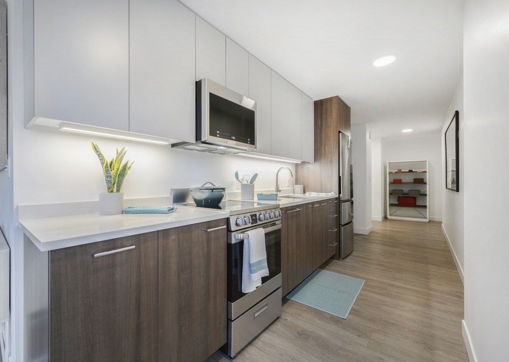 A long, modern kitchen with one counter.