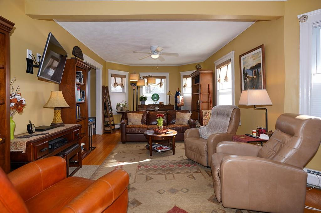 An open and long living room with lots of furniture.
