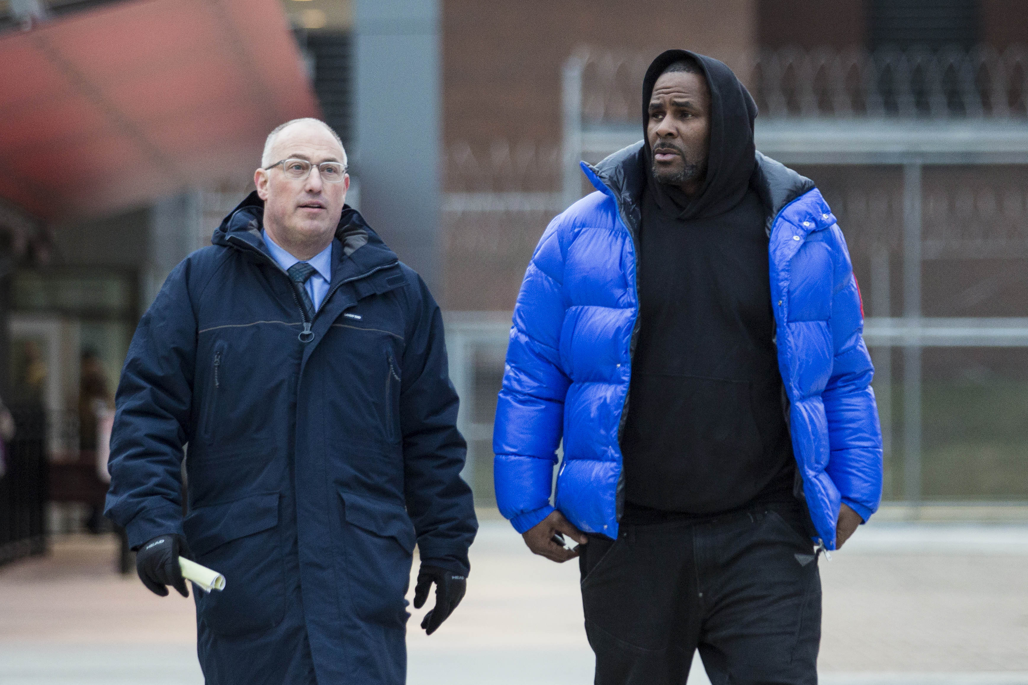 R. Kelly walks out of Cook County Jail with his defense attorney, Steve Greenberg, after posting $100,000 bail, Monday afternoon, Feb. 25, 2019. The R&B singer has entered a not guilty plea to all 10 counts of aggravated criminal sexual abuse he faces in Cook County.