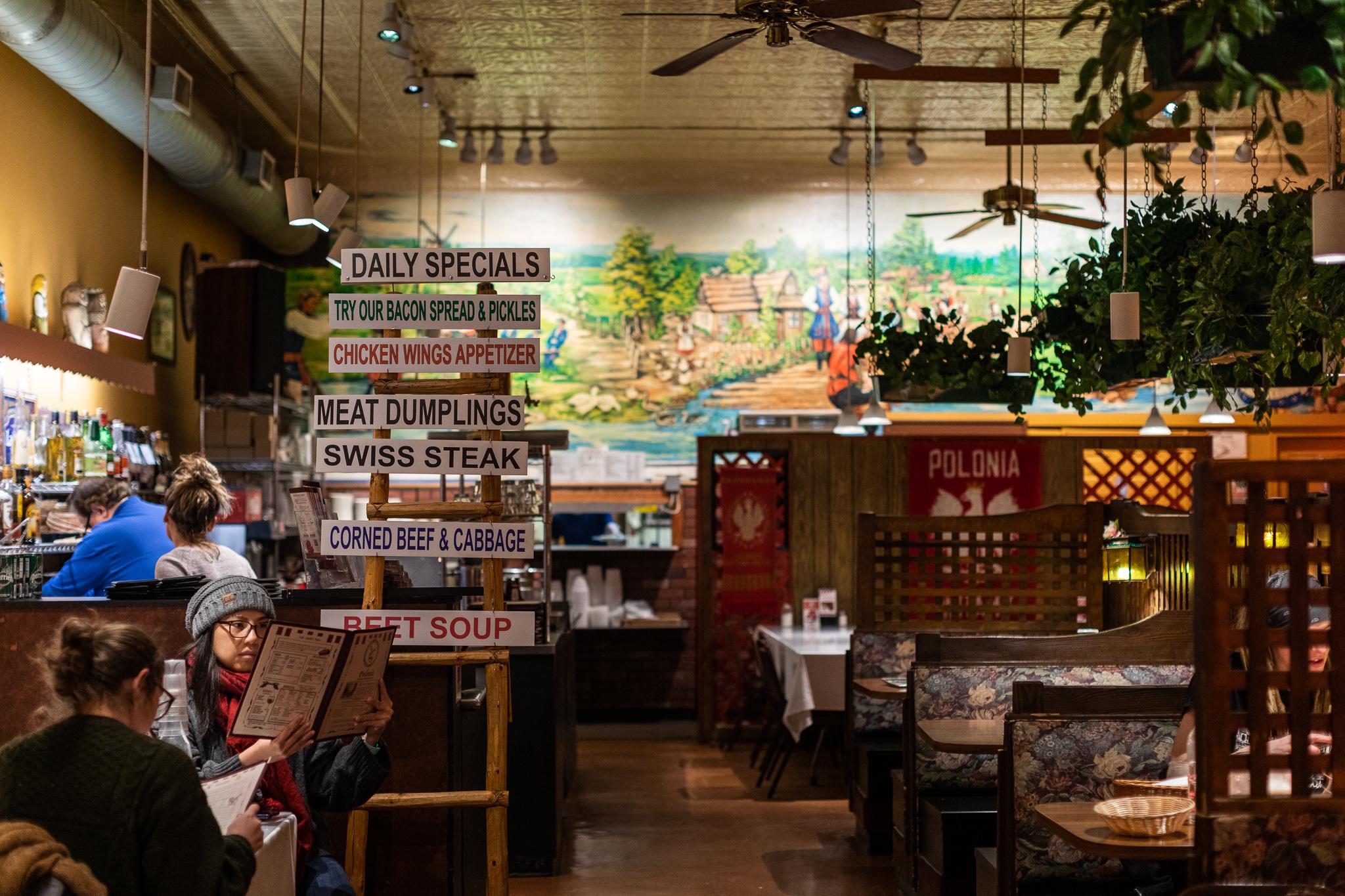 Customers look at menus inside Polonia restaurant.