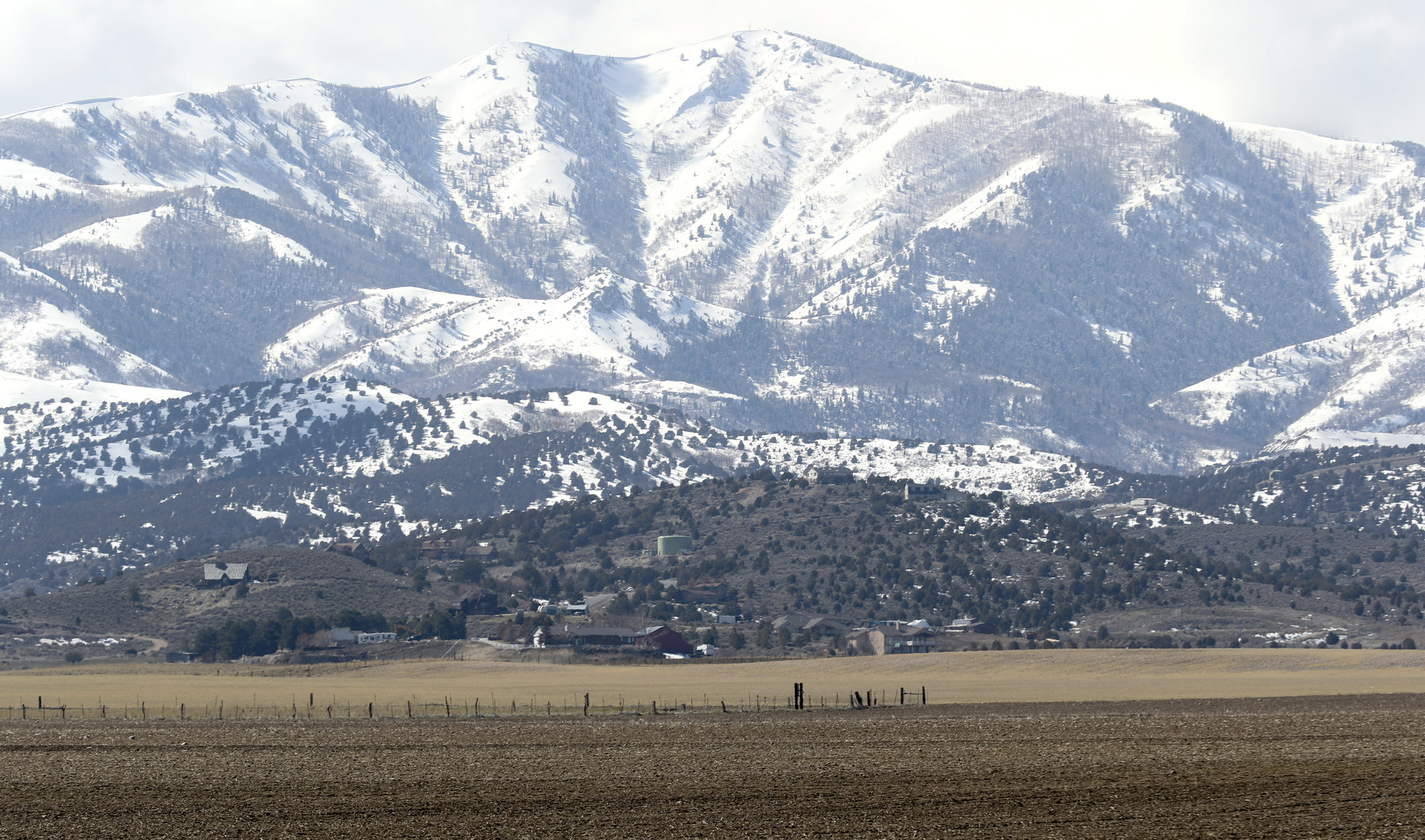Land between 6300 West and 8500 West and 12400 South and 13100 South in unincorporated Salt Lake County, foreground, is pictured on Monday, March 11, 2019.