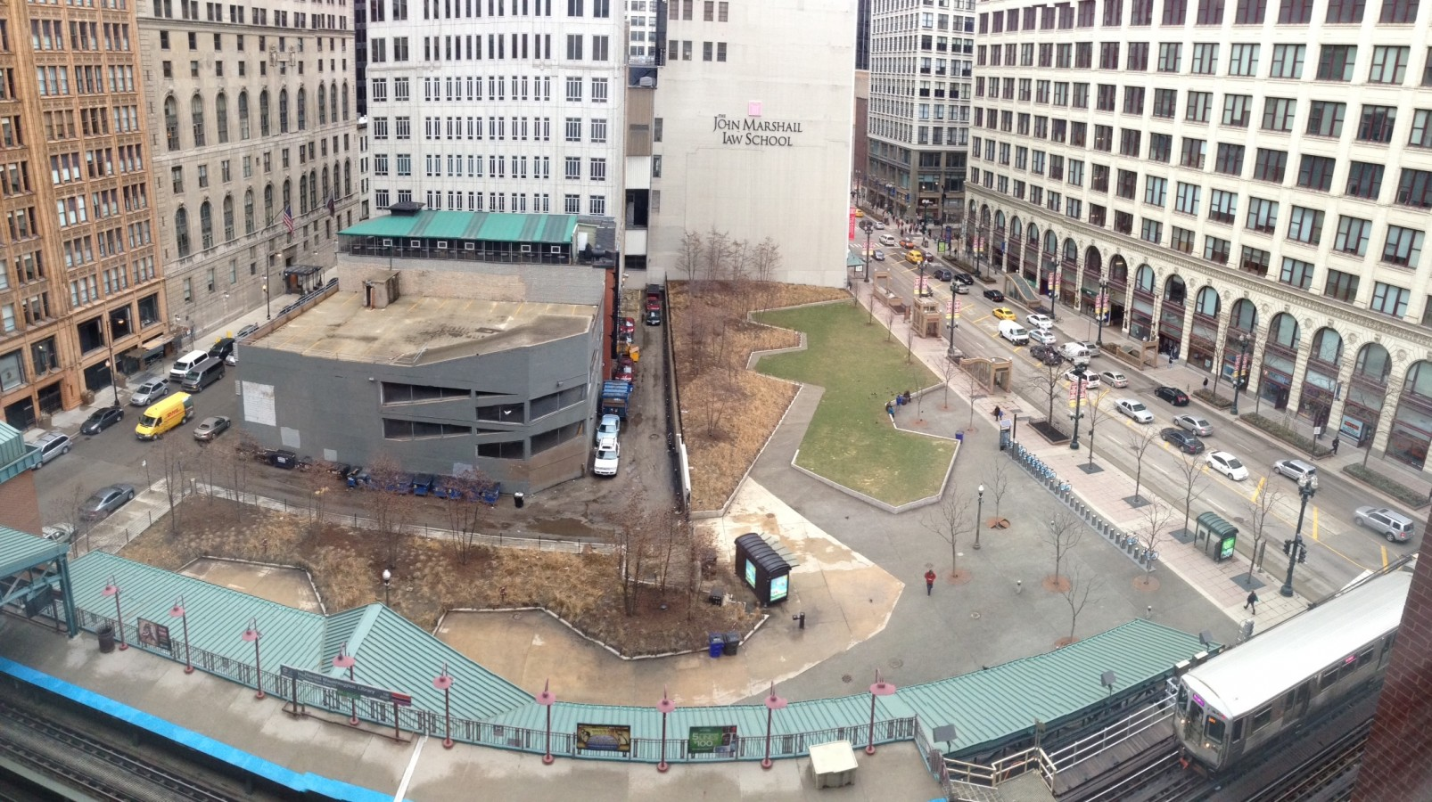 The site where the new development will be (left) and Pritzker Park (right). The city hopes that the new development will bring people to the block year-round.