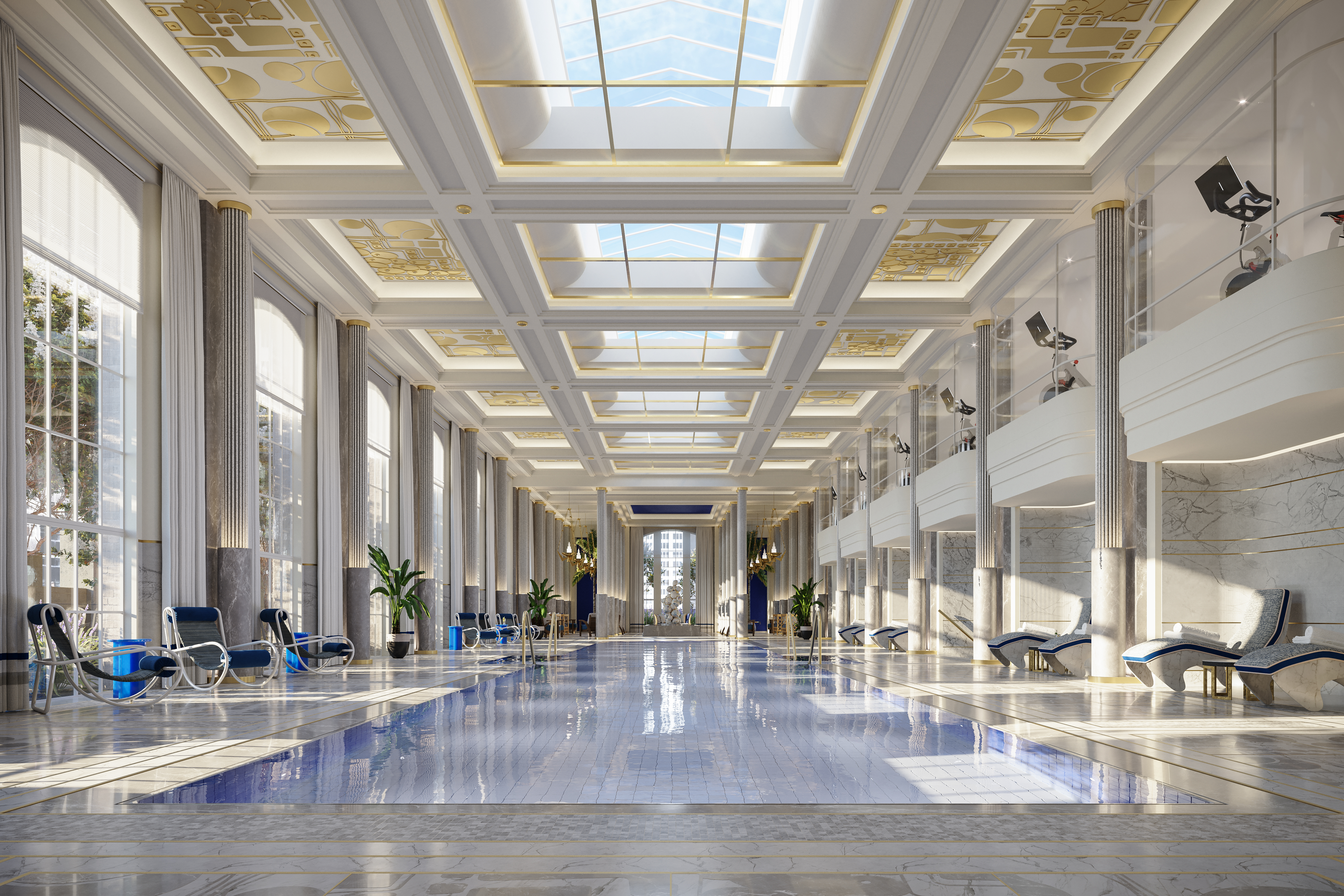 A large indoor swimming pool surrounded by doric columns, large windows, and a skylight.