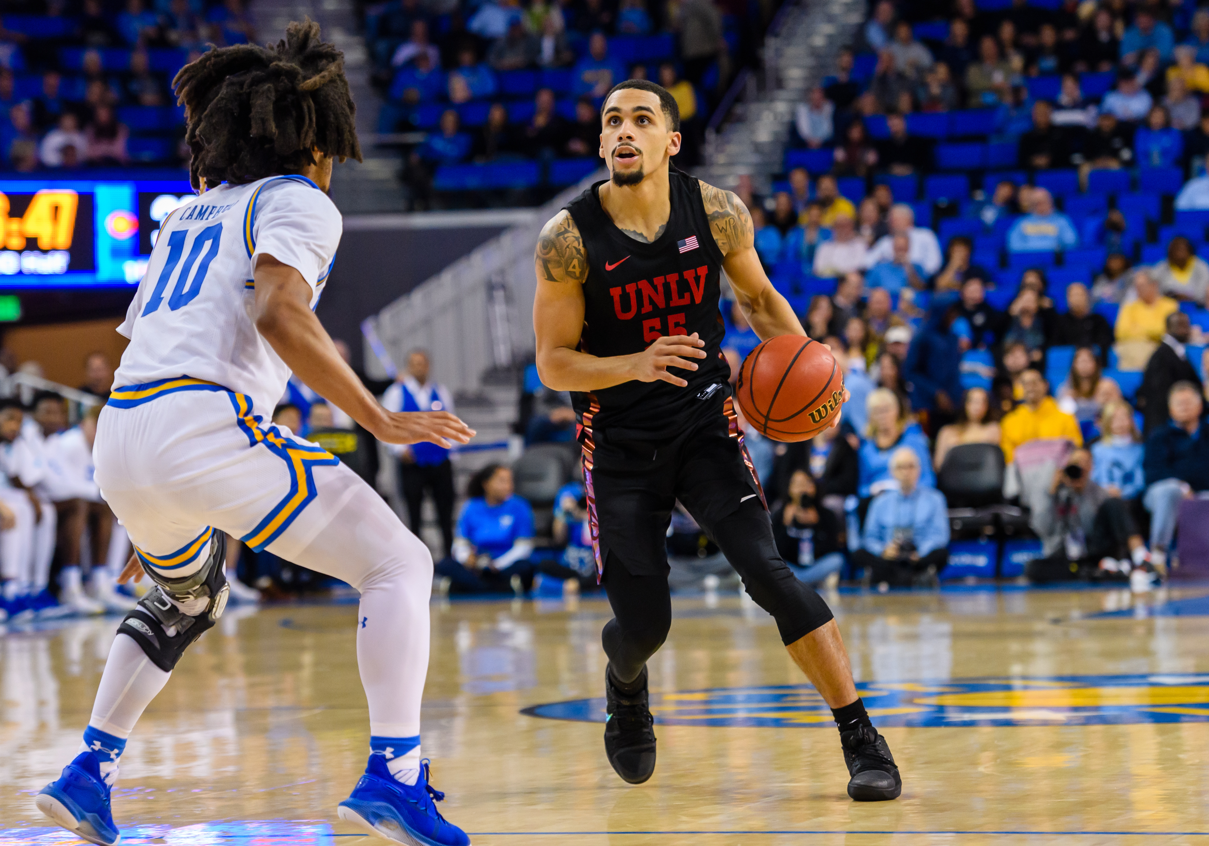 UNLV Rebels guard Elijah Mitrou-Long looks to the basket during a college basketball game between the UNLV Rebels and the UCLA Bruins on November 15, 2019, at Pauley Pavilion in Los Angeles, CA.