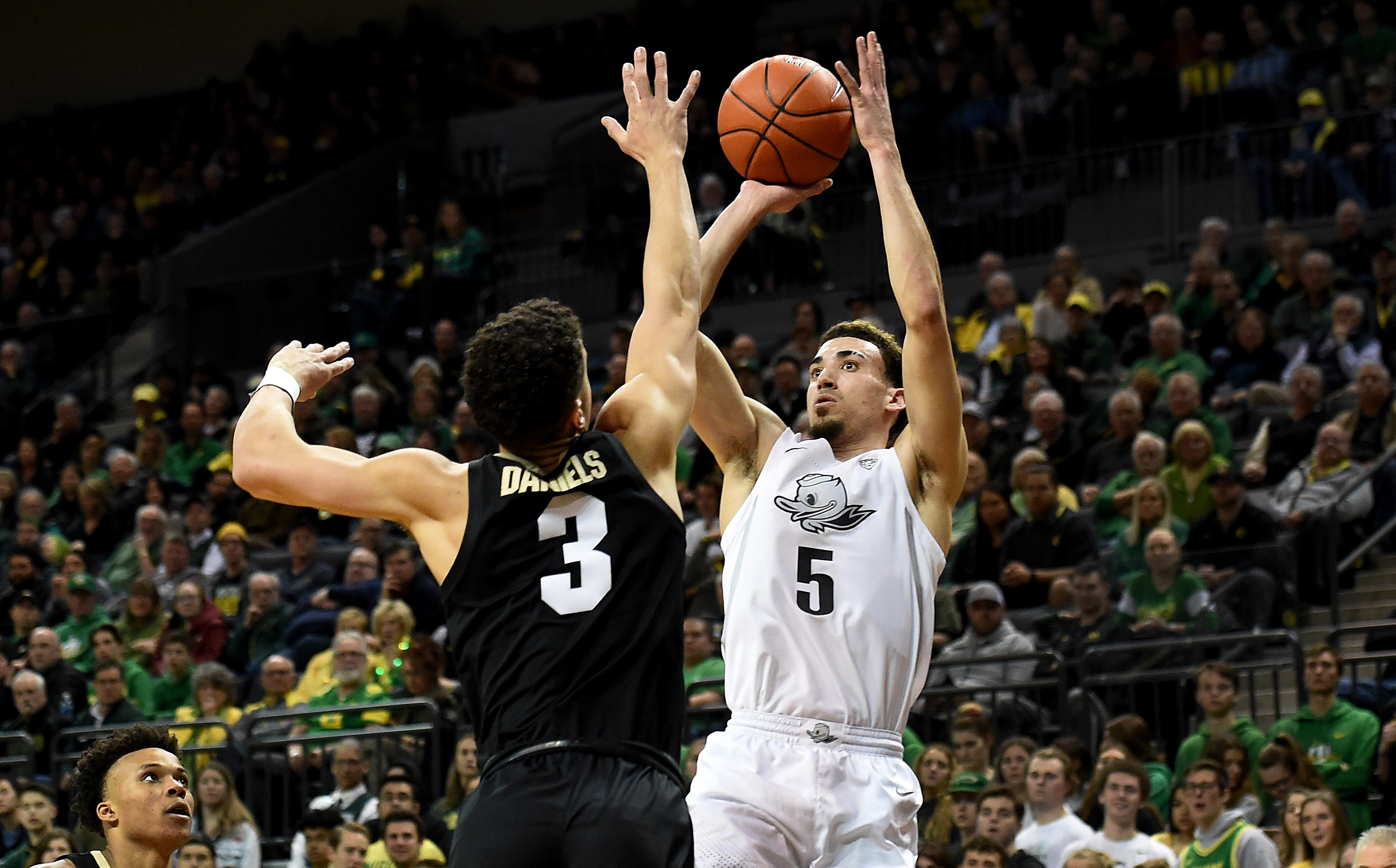 Chris Duarte of the Oregon Ducks shoots the ball over Maddox Daniels of the Colorado Buffaloes during the first half at Matthew Knight Arena on February 13, 2020 in Eugene, Oregon.
