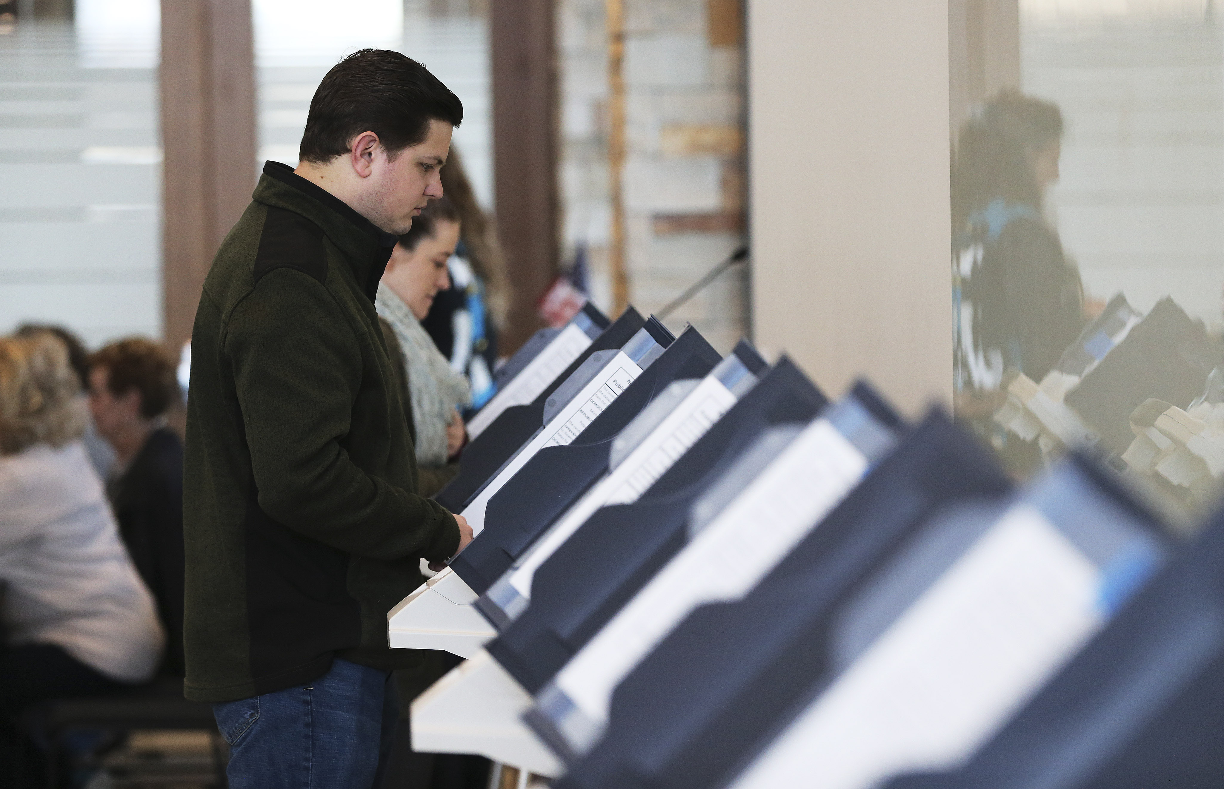 Zachery Prince votes at Cottonwood Heights City Hall in Cottonwood Heights on Tuesday, March 3, 2020.