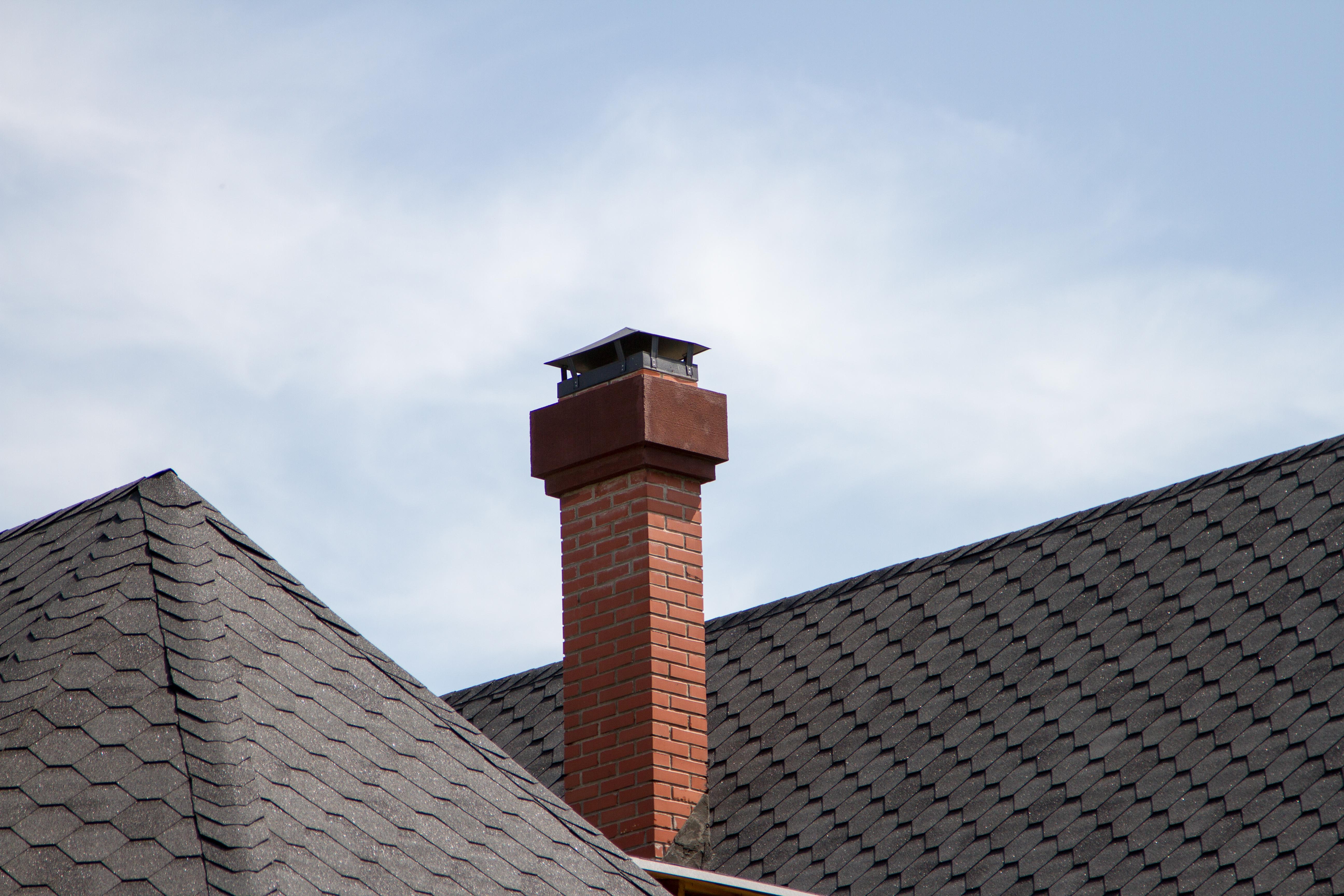 A brick chimney on a house.