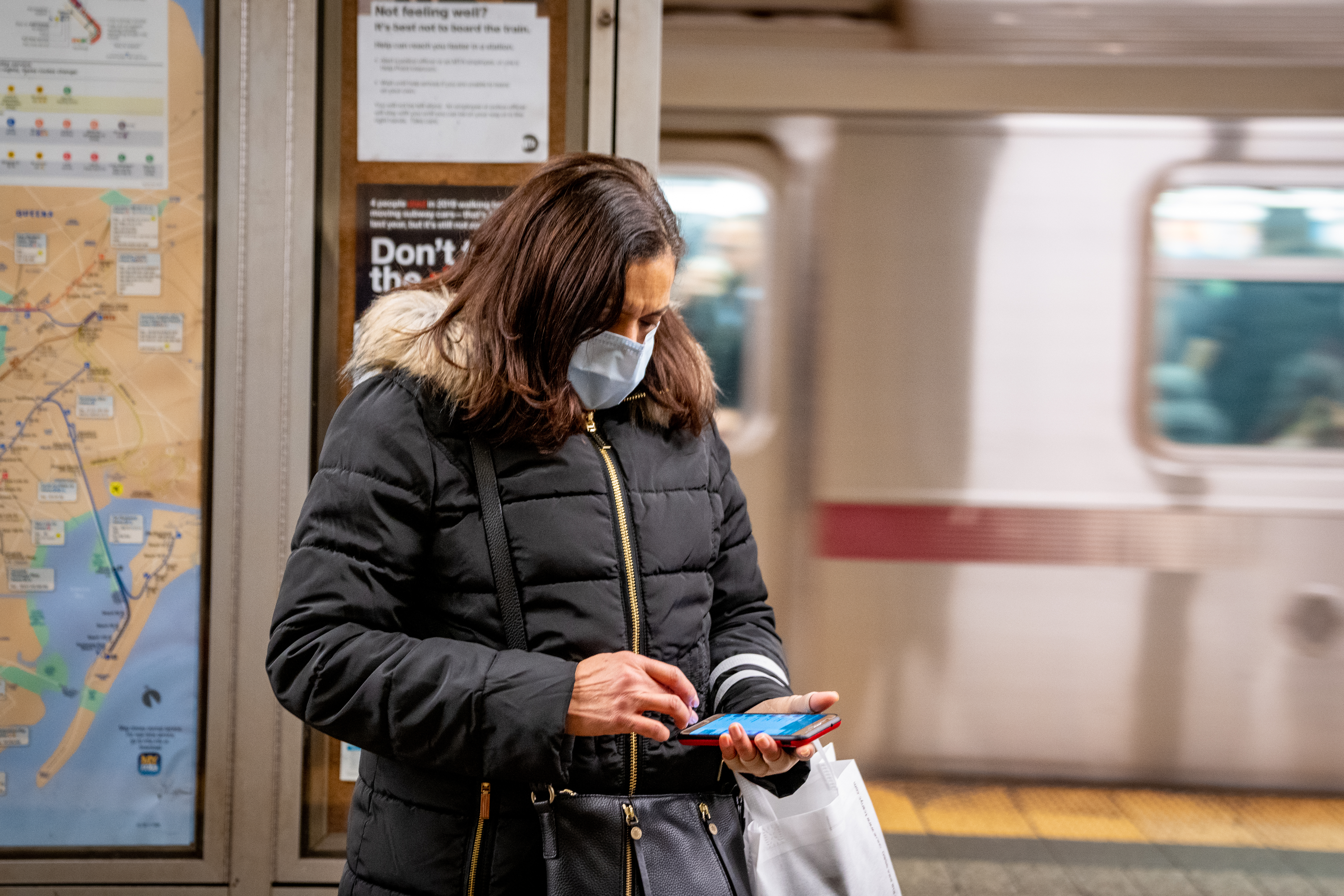 A woman wearing a face mask in a New York City train station on March 5, 2020.