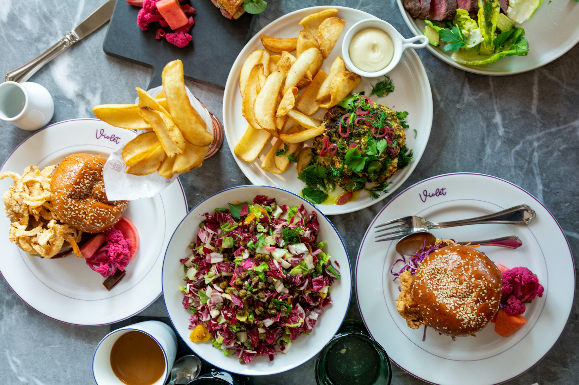 A plate of California French food on a sunny day, with salads and sandwiches.