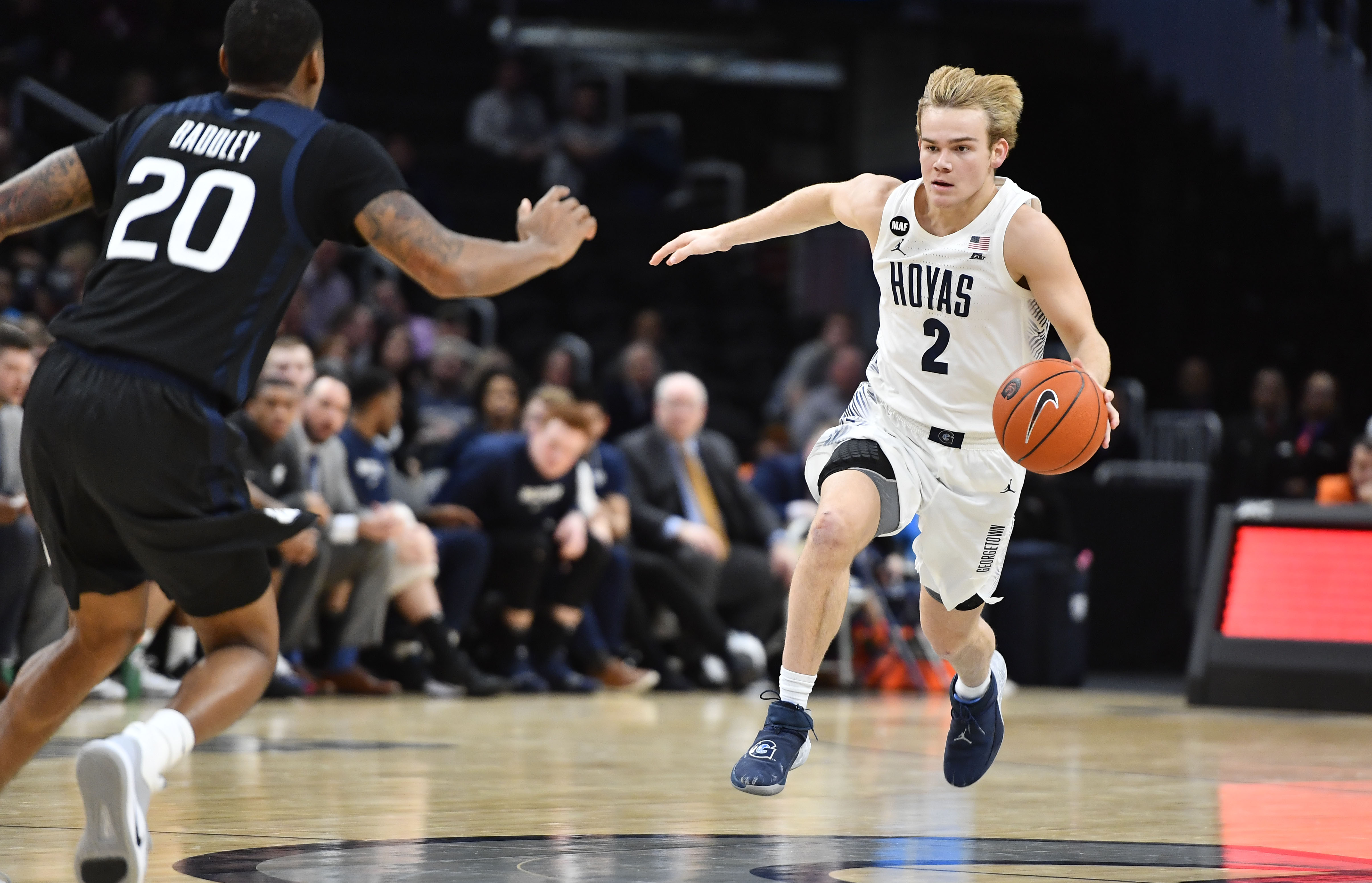Georgetown Hoyas guard Mac McClung advances the ball as Butler Bulldogs guard Henry Baddley defends during the second half at Capital One Arena.