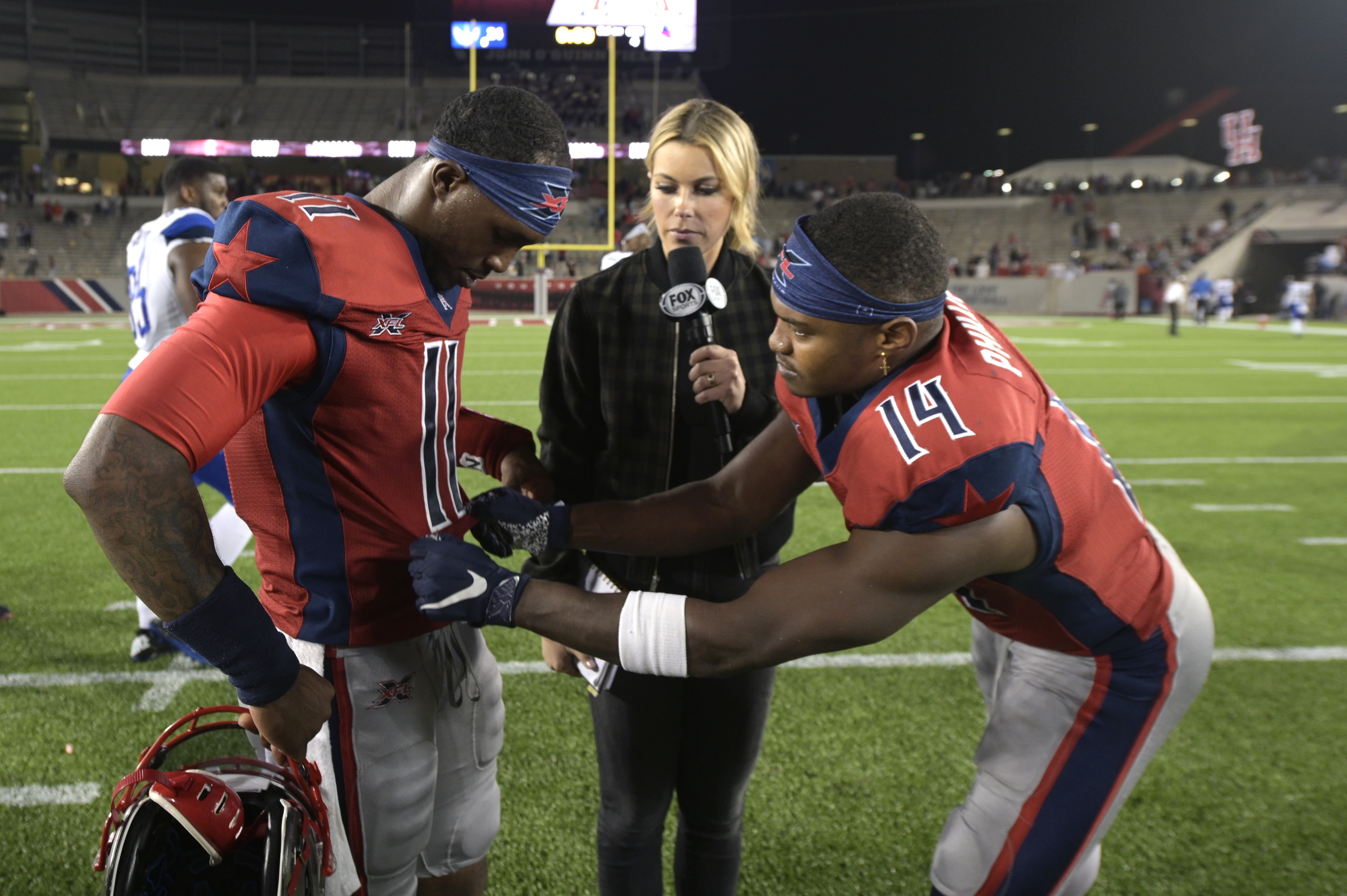 P.J. Walker and Cam Phillips of the Houston Roughnecks are interviewed after the game against the St. Louis BattleHawks at TDECU Stadium on February 16, 2020 in Houston, Texas.