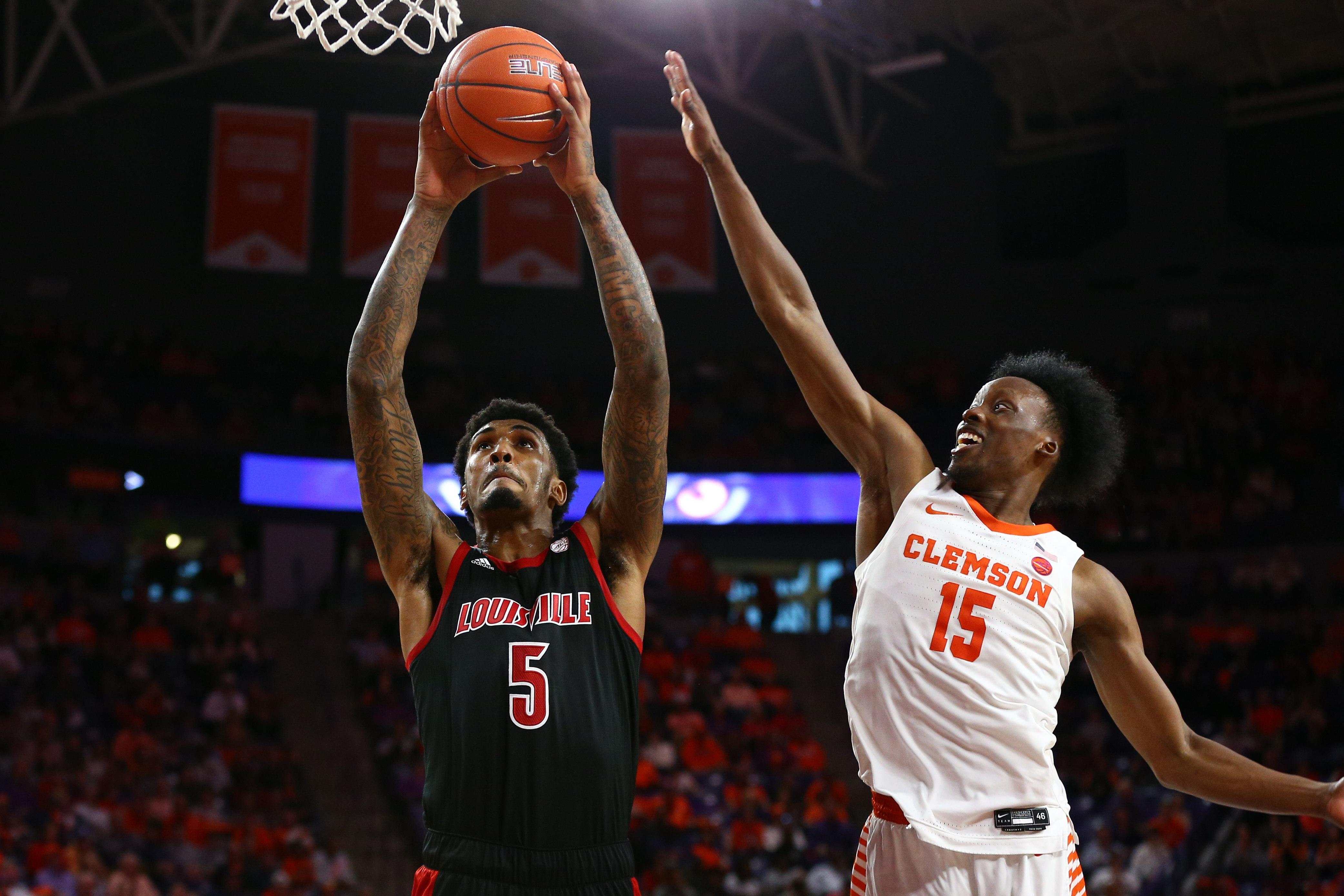 Louisville Cardinals forward Malik Williams shoots the ball against Clemson Tigers guard John Newman III during the second half at Littlejohn Coliseum.