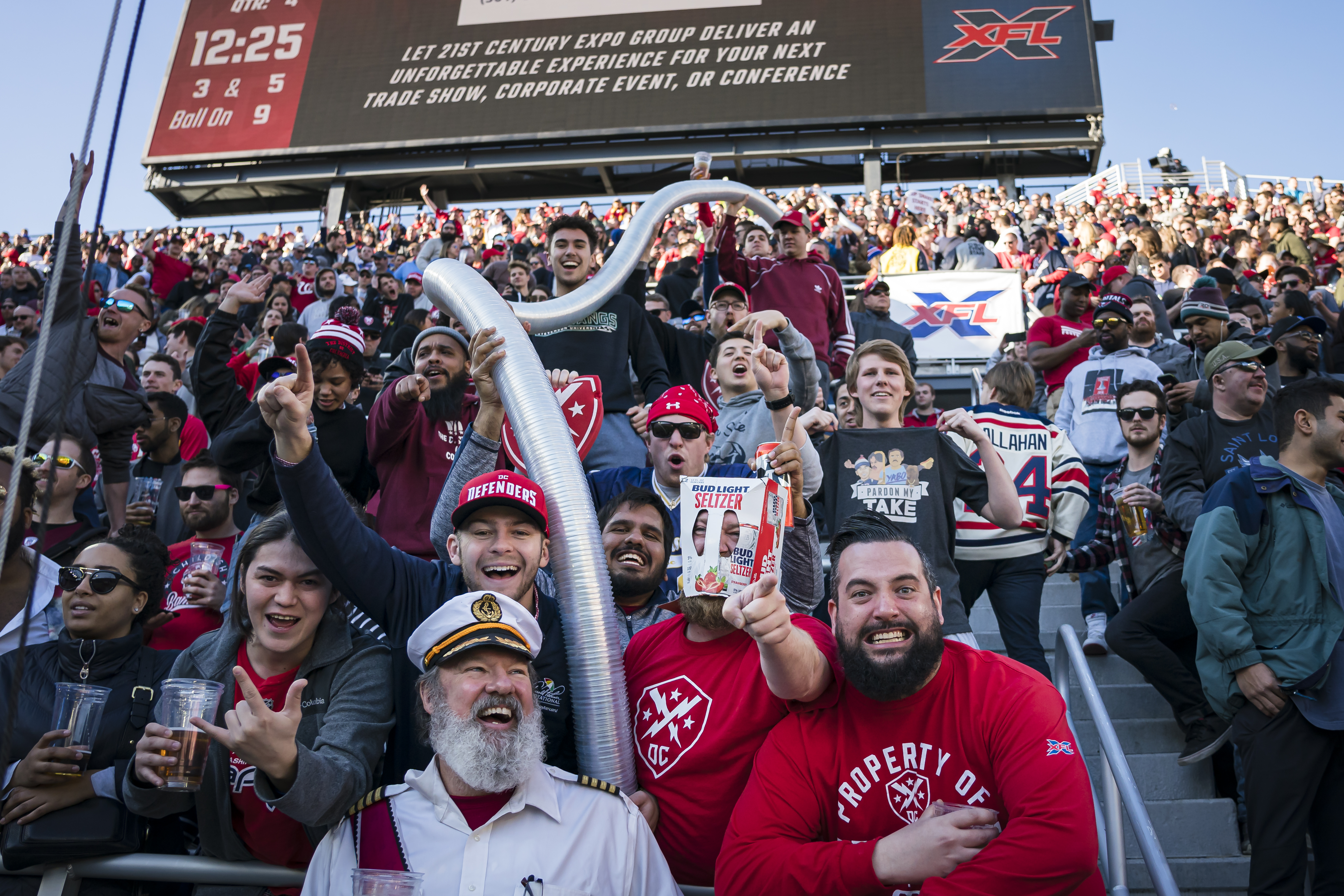 Fans celebrate at the start of the beer cup snake during the second half of the XFL game between the DC Defenders and the St. Louis Battlehawks at Audi Field on March 8, 2020 in Washington, DC.