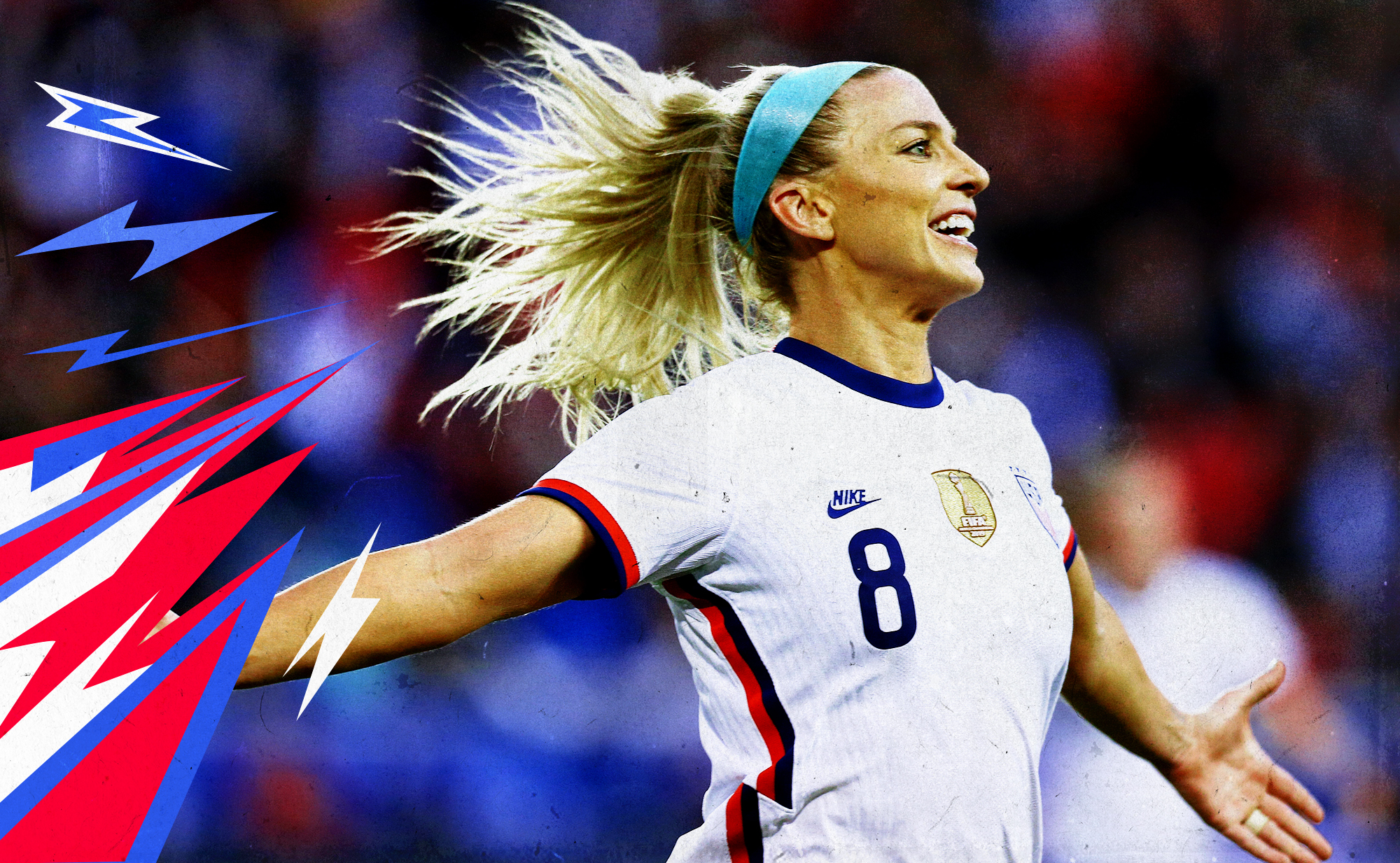 Julie Ertz celebrating her goal against Spain by running with her arms outstretched, her hair flowing behind her.