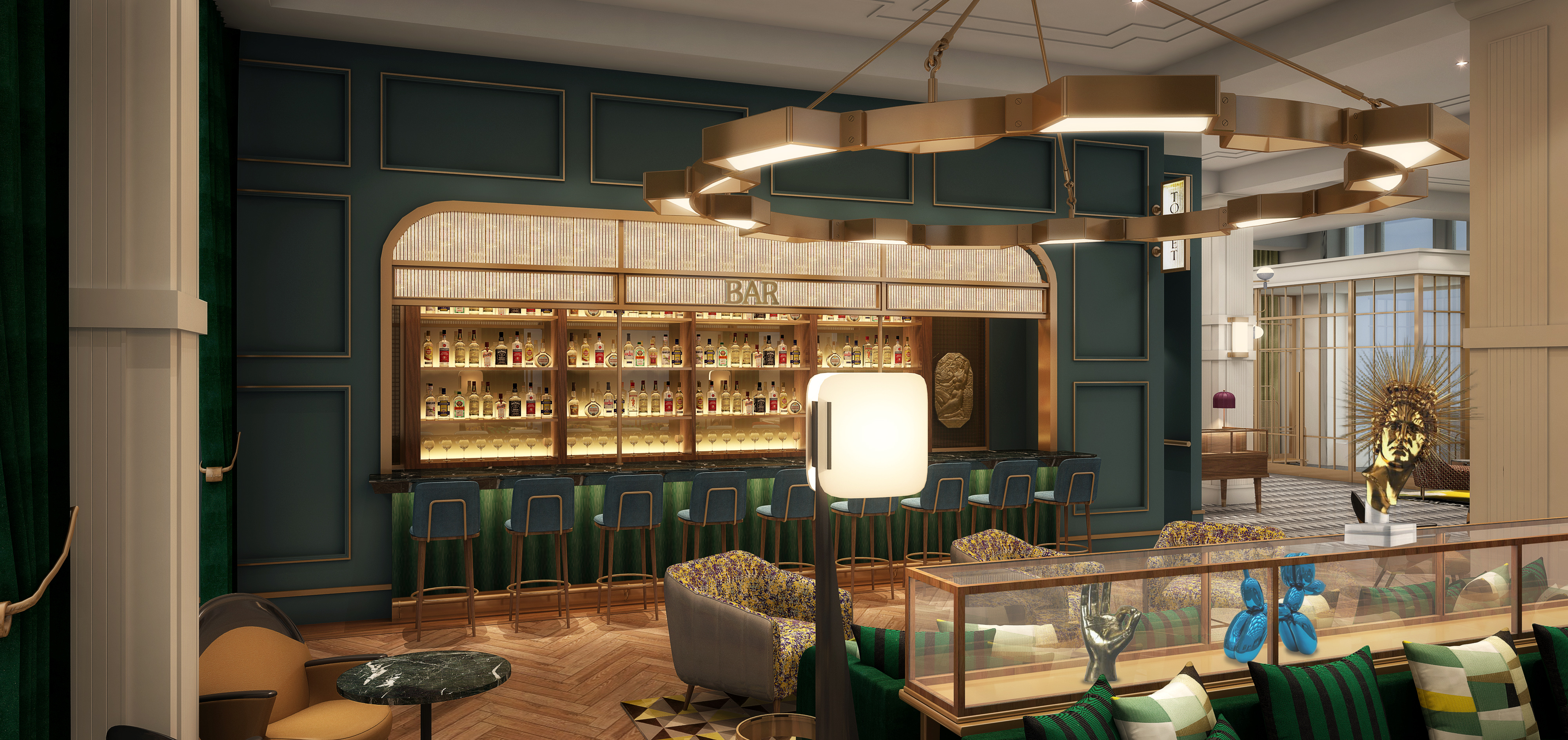 interior of restaurant with green and gold decor and a bar