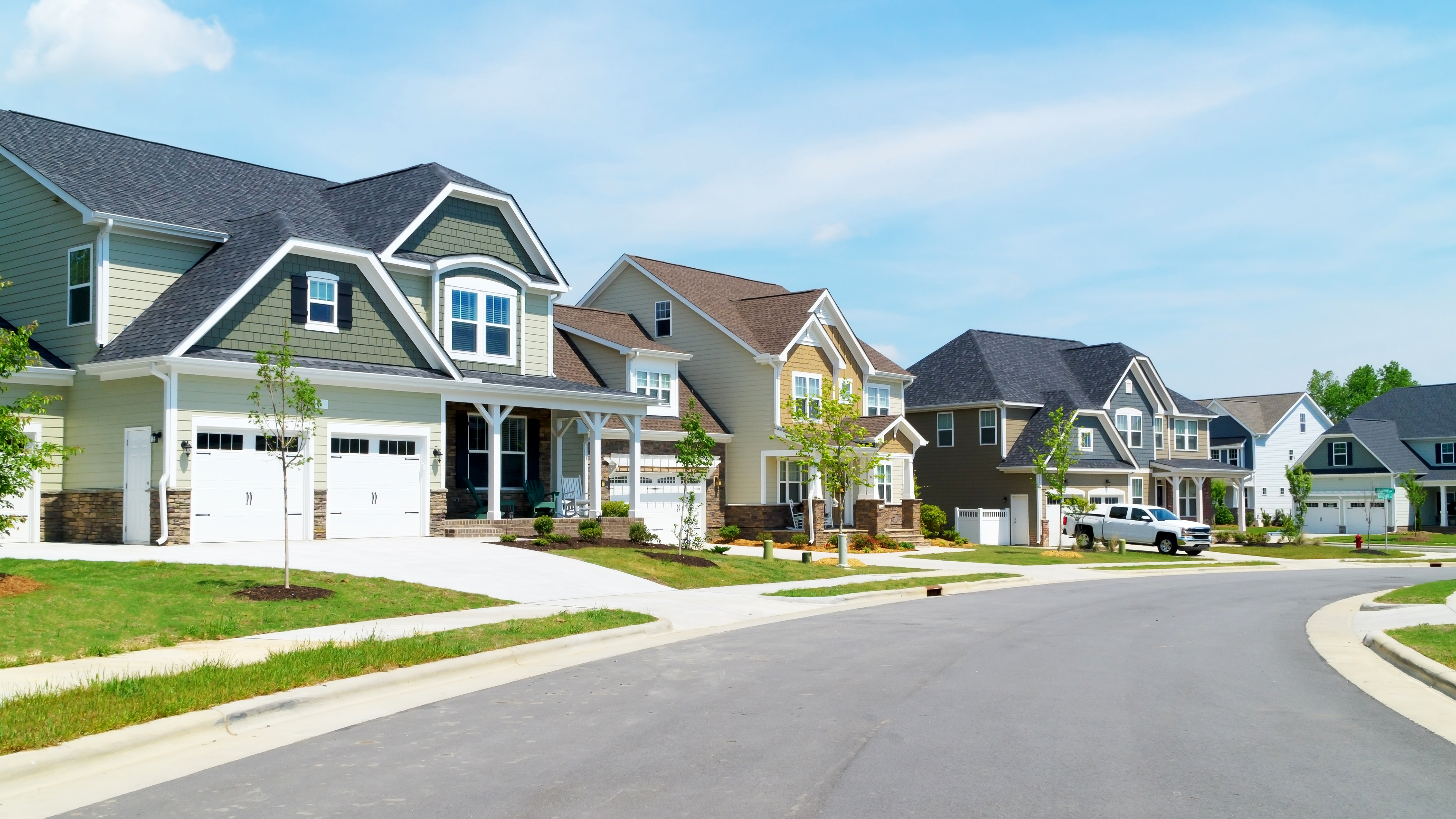A row of two-story homes on an average suburban street in the United States.