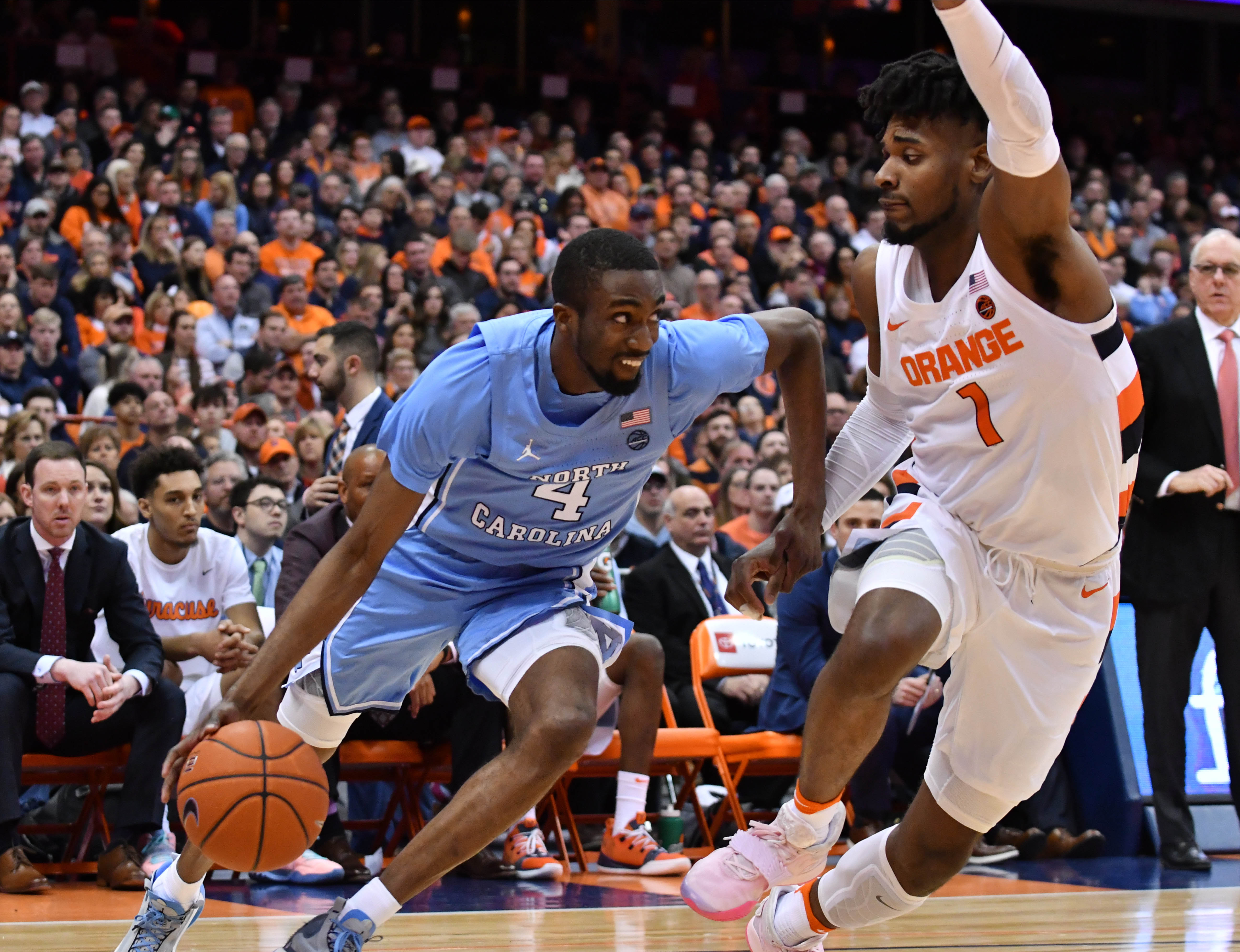 North Carolina Tar Heels guard Brandon Robinson works to break a full court press from Syracuse Orange forward Quincy Guerrier (1) in the second half at the Carrier Dome.