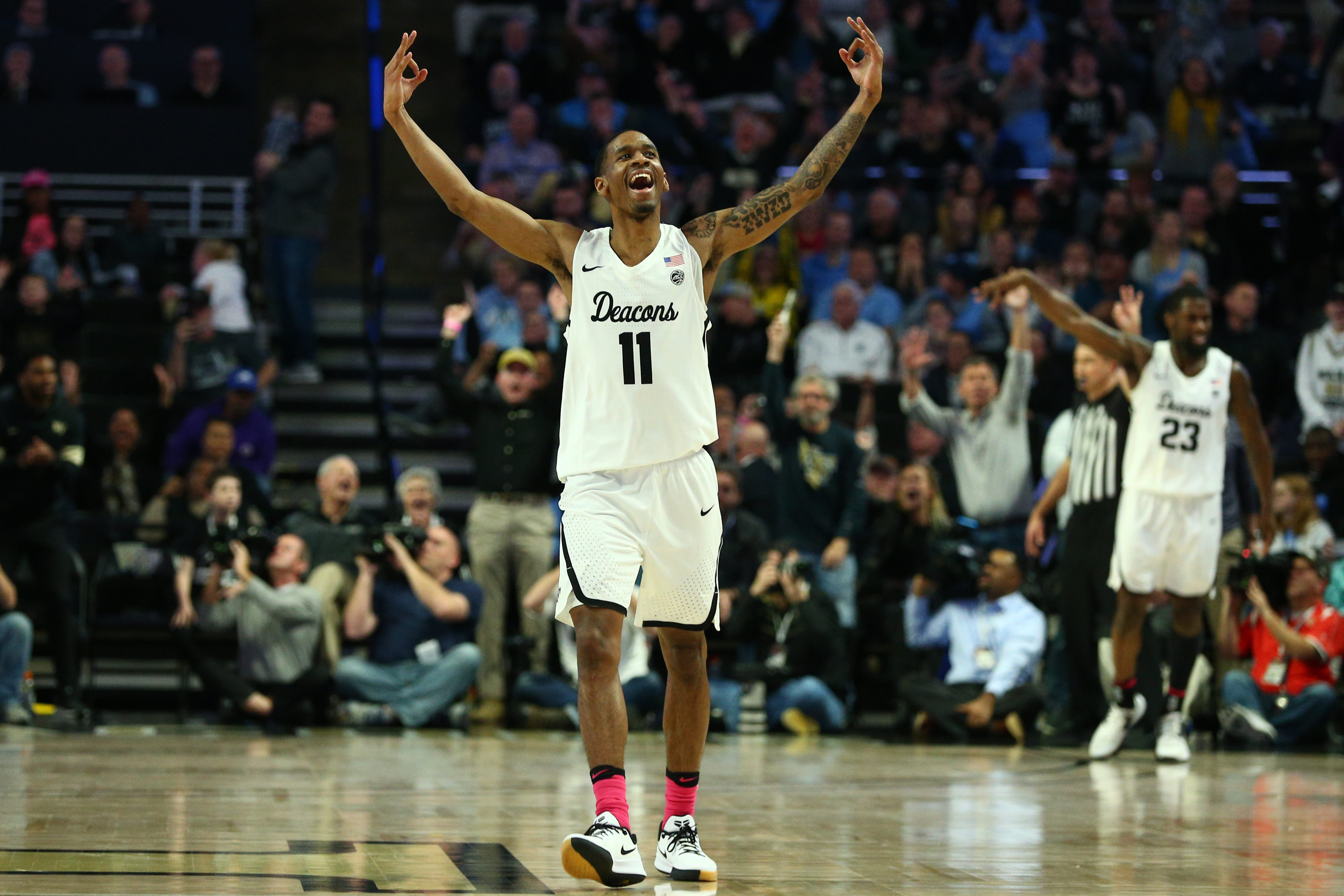 Wake Forest Demon Deacons guard Torry Johnson celebrates after a three point basket during the second half against the North Carolina Tar Heels at Lawrence Joel Veterans Memorial Coliseum.