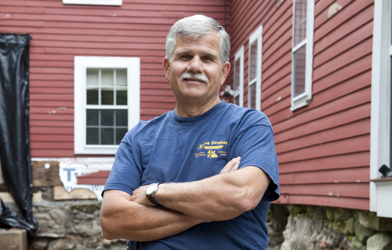 Tom Silva wearing Silva Brothers Construction Shirt