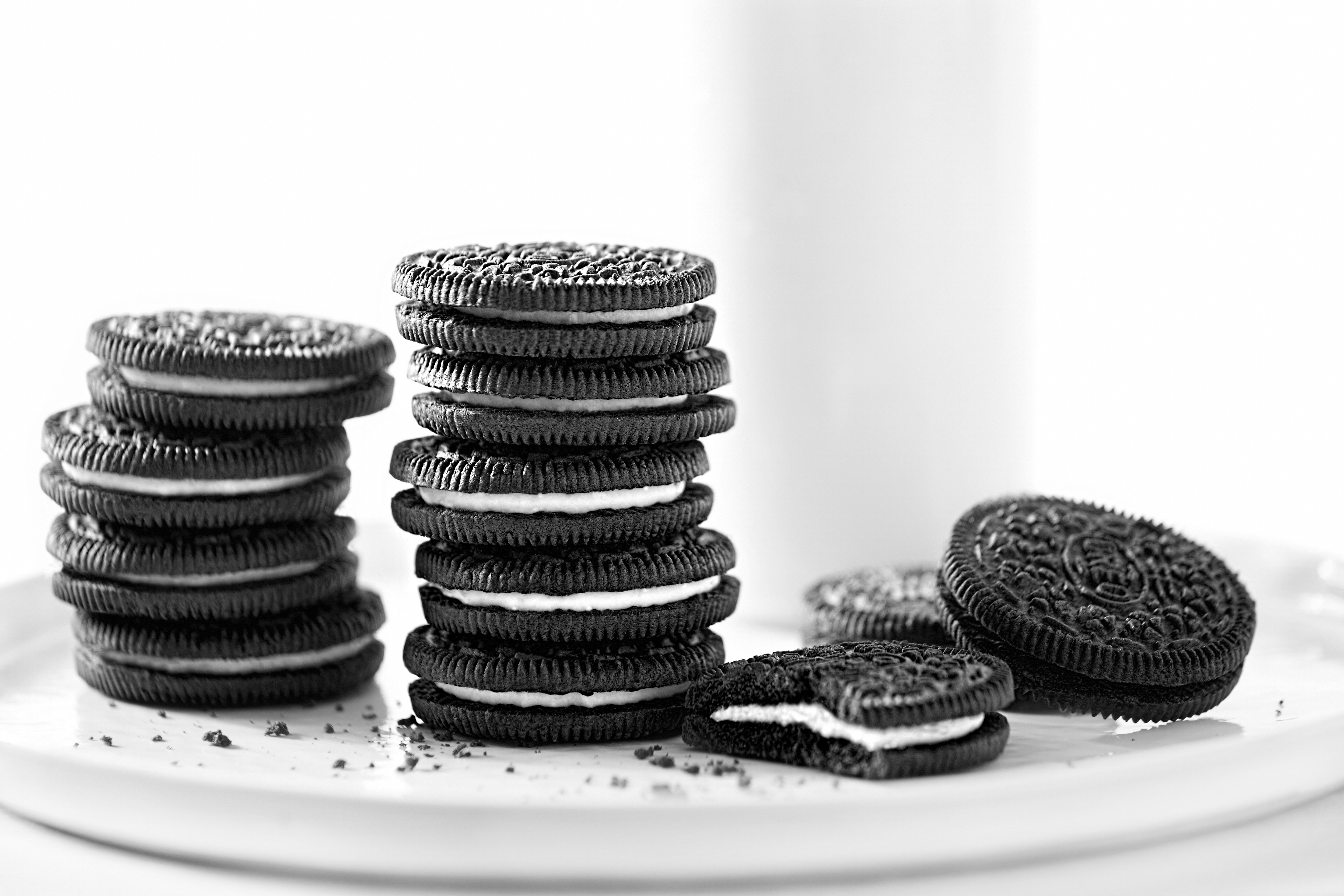 A stack of Oreo cookies on a white table.