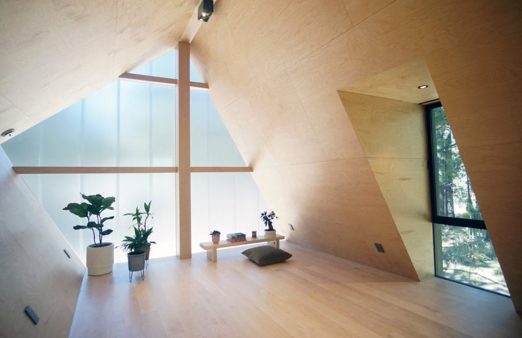 Light filled room with polycarbonate wall.