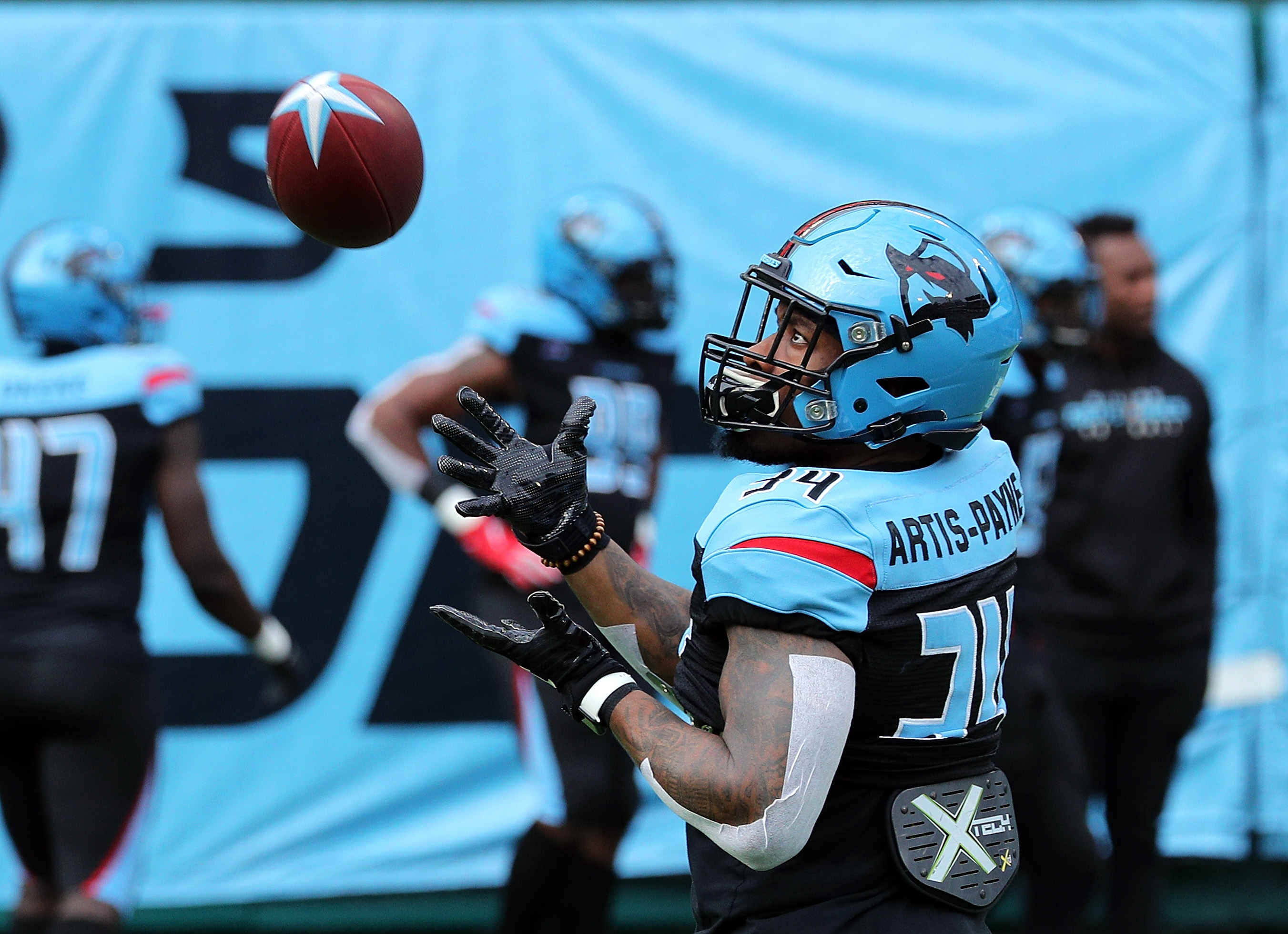 Cameron Artis-Payne #34 of the Dallas Renegades catches a pass during warm ups before an XFL football game against the New York Guardians on March 07, 2020 in Arlington, Texas.