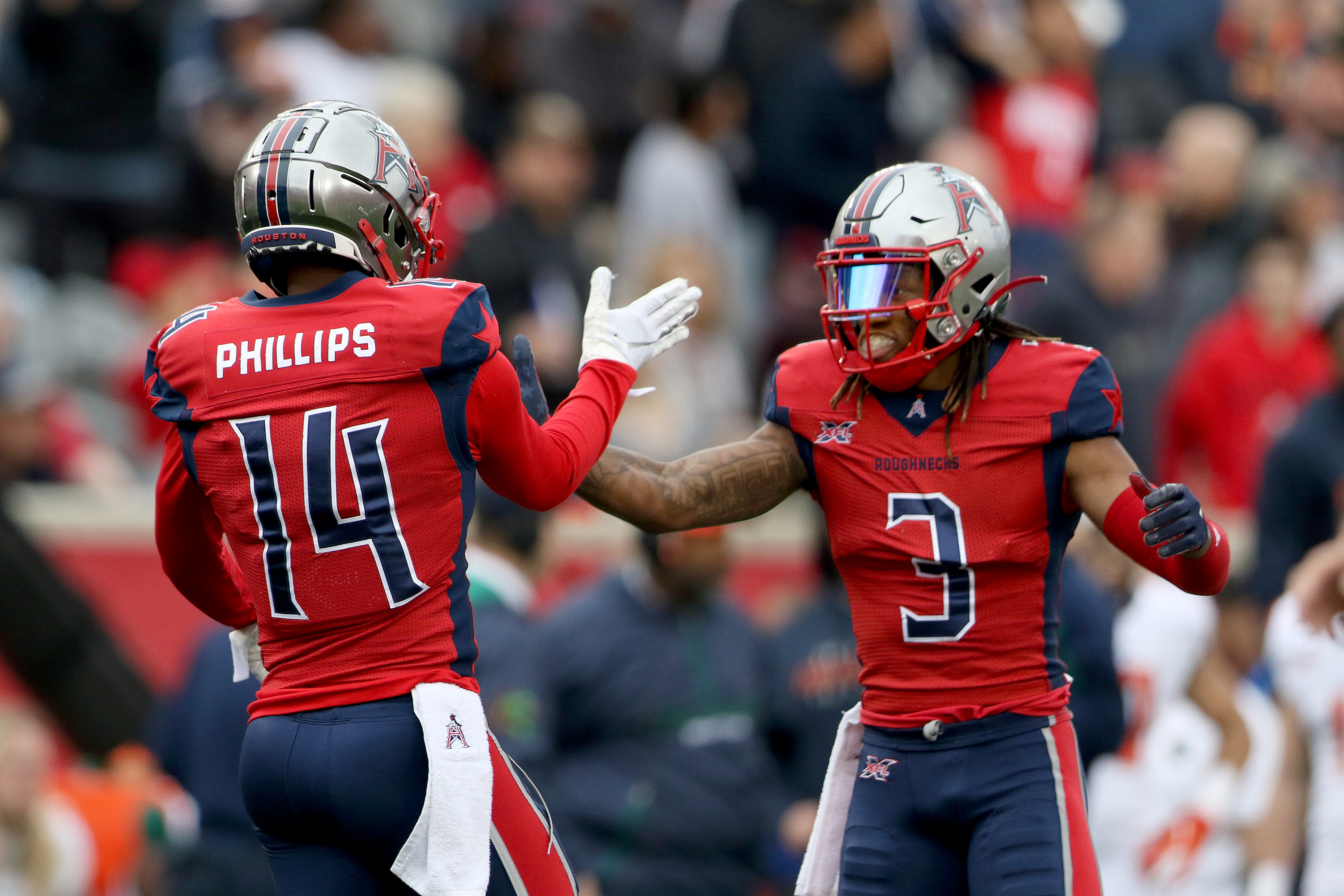 Cam Phillips #14 of the Houston Roughnecks with Sam Mobley #3 during the XFL game against the Seattle Dragons at TDECU Stadium on March 7, 2020 in Houston, Texas.