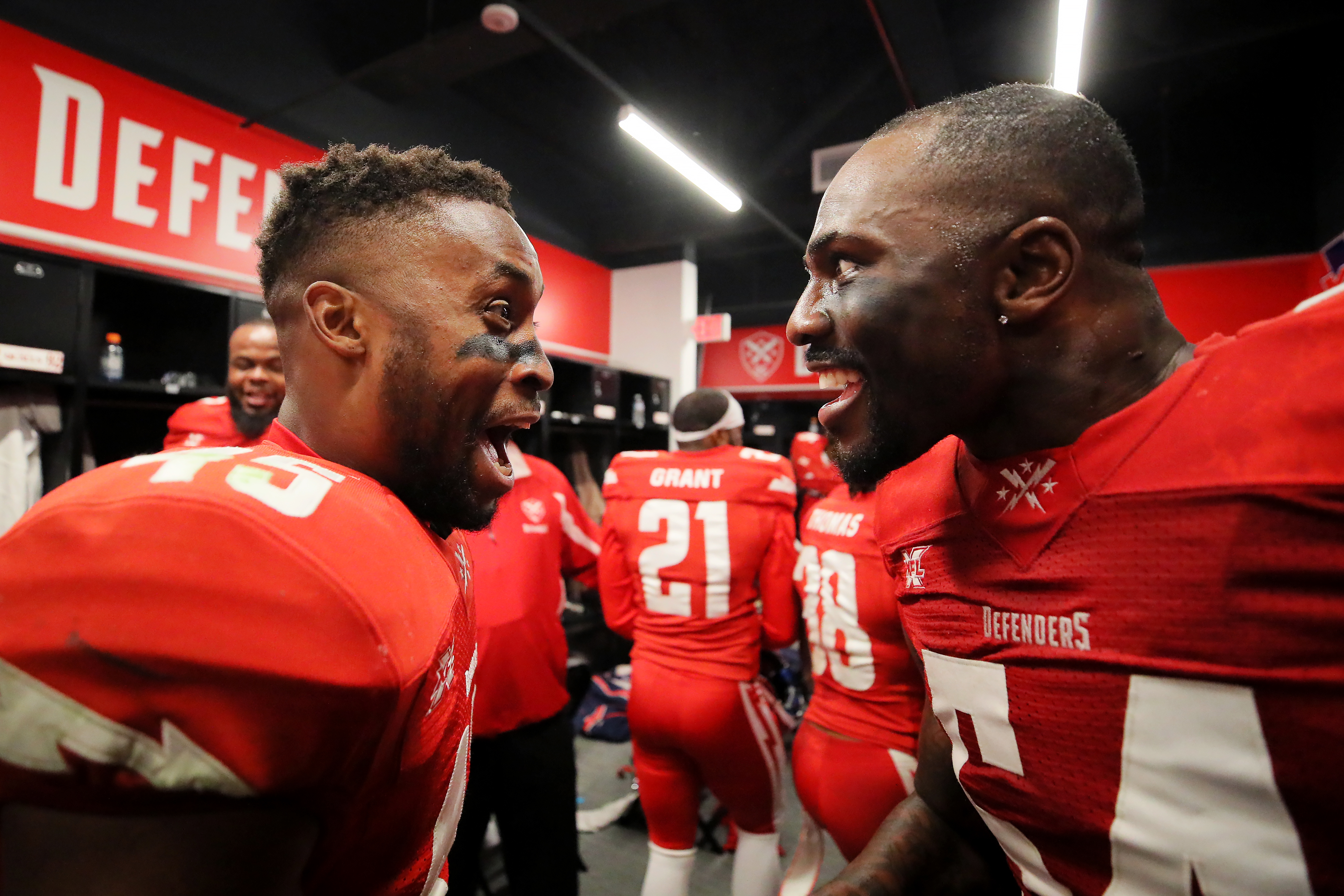 Rahim Moore #45 and Jonathan Massaquoi #54 of the DC Defenders celebrate after the XFL game against the St. Louis BattleHawks at Audi Field on March 8, 2020 in Washington, DC.