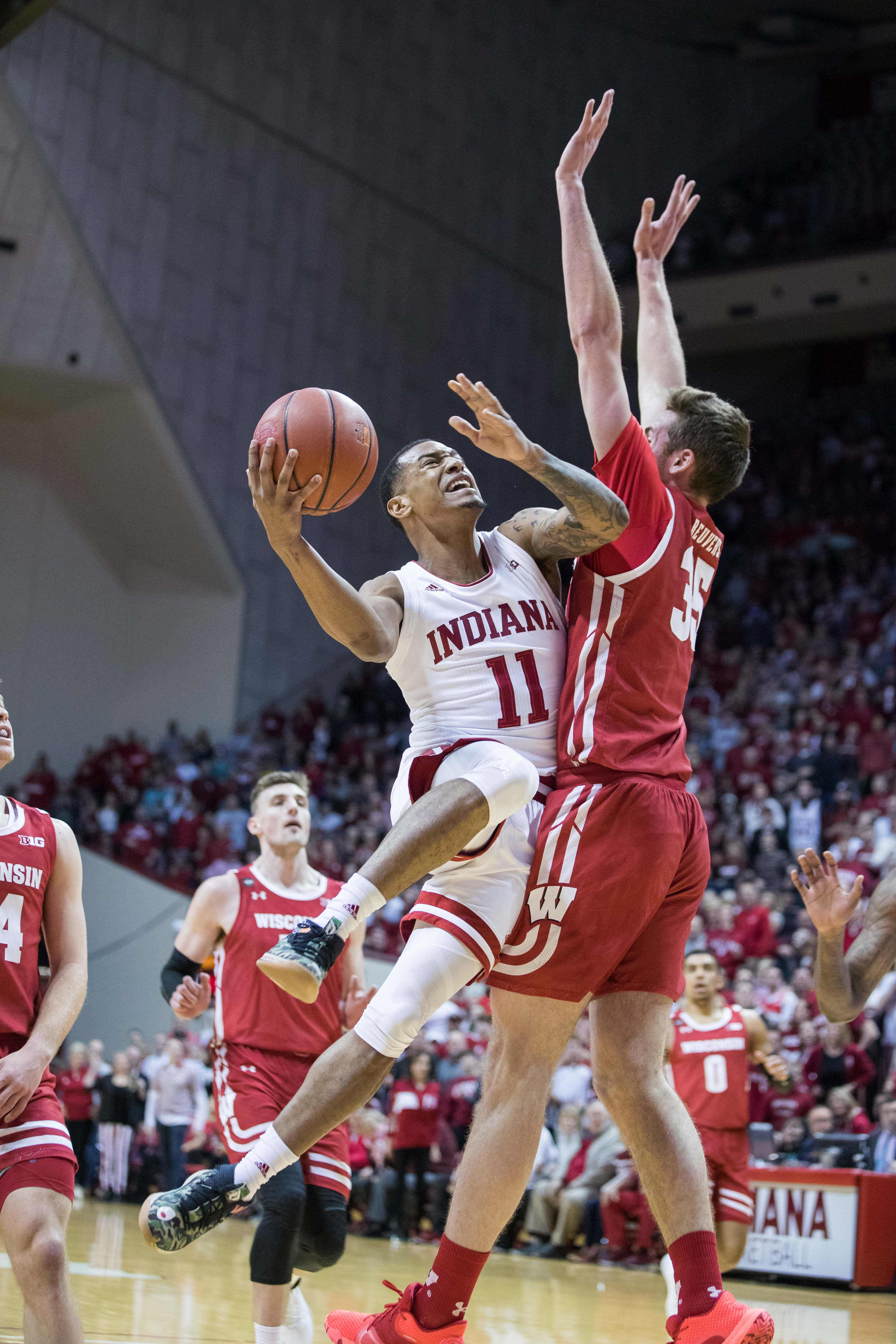 Indiana Hoosiers guard Devonte Green shoots the ball while Wisconsin Badgers forward Nate Reuvers defends in the first half at Simon Skjodt Assembly Hall