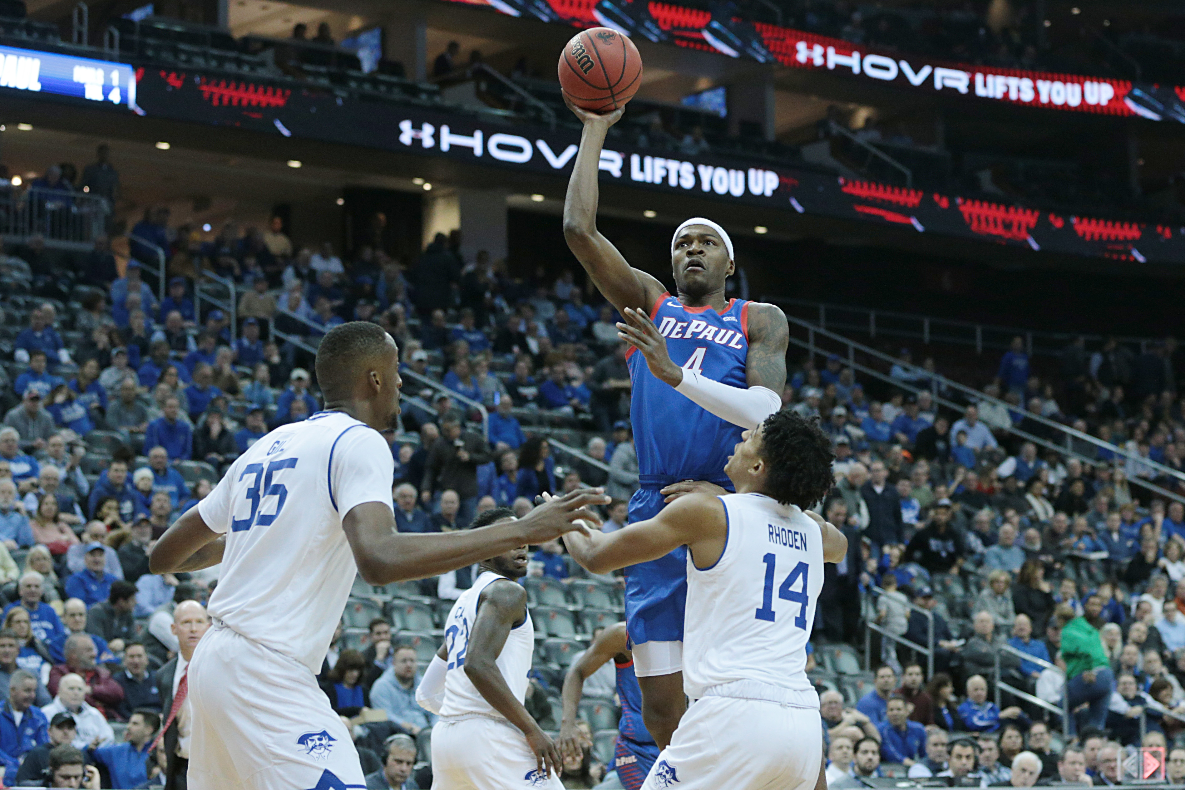 DePaul Blue Demons forward Paul Reed shoots the ball as Seton Hall Pirates guard Jared Rhoden  and center Romaro Gill defend during the first half at Prudential Center
