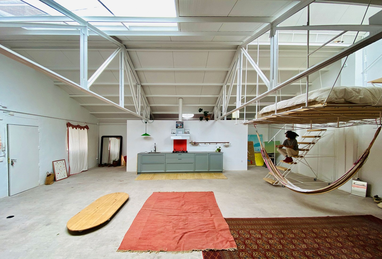 Warehouse space elevated bed and high ceilings.