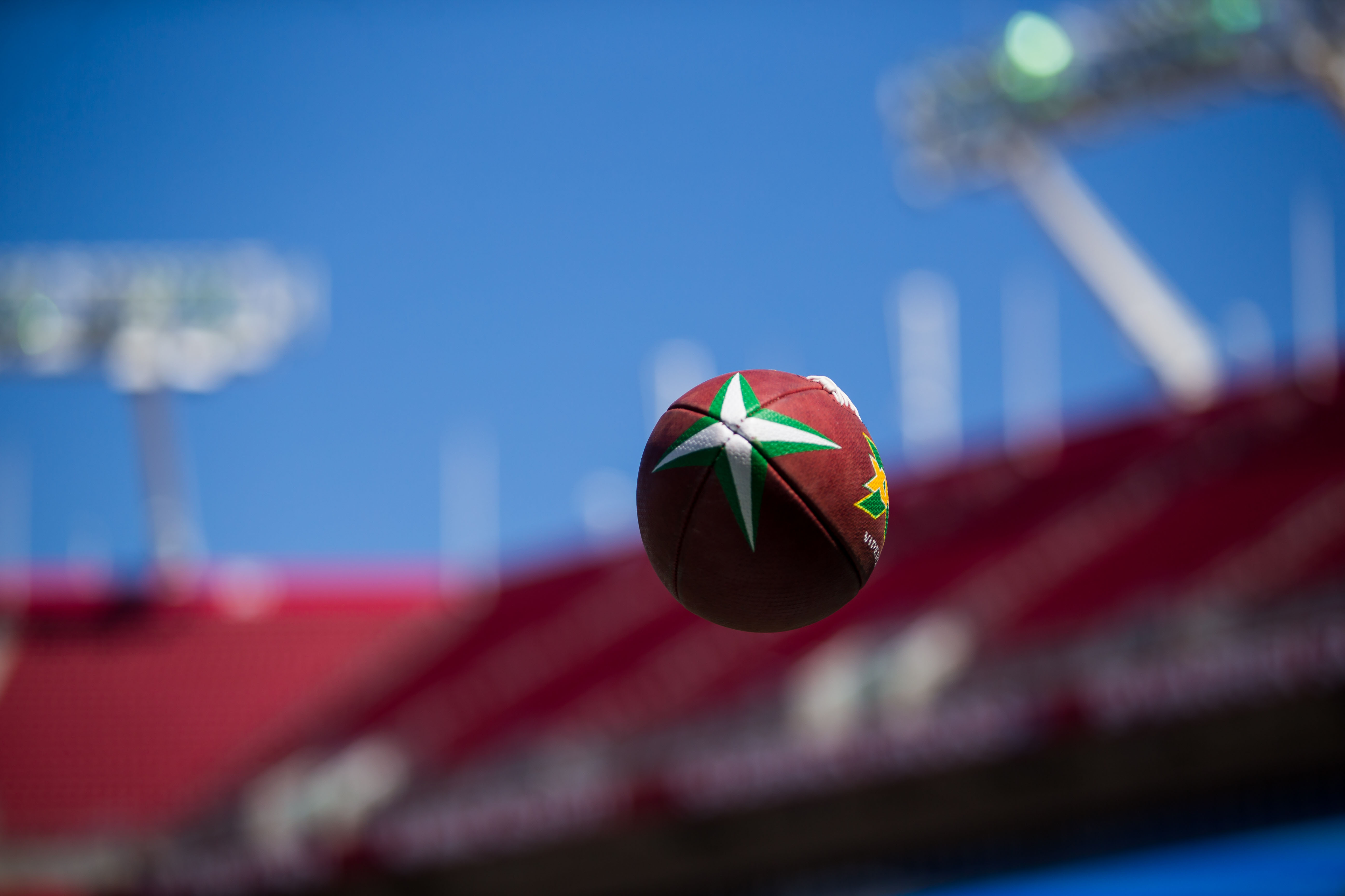 A football with the XFL design spirals through the air during warmups before a game between the Houston Roughnecks and the Tampa Bay Vipers at Raymond James Stadium.