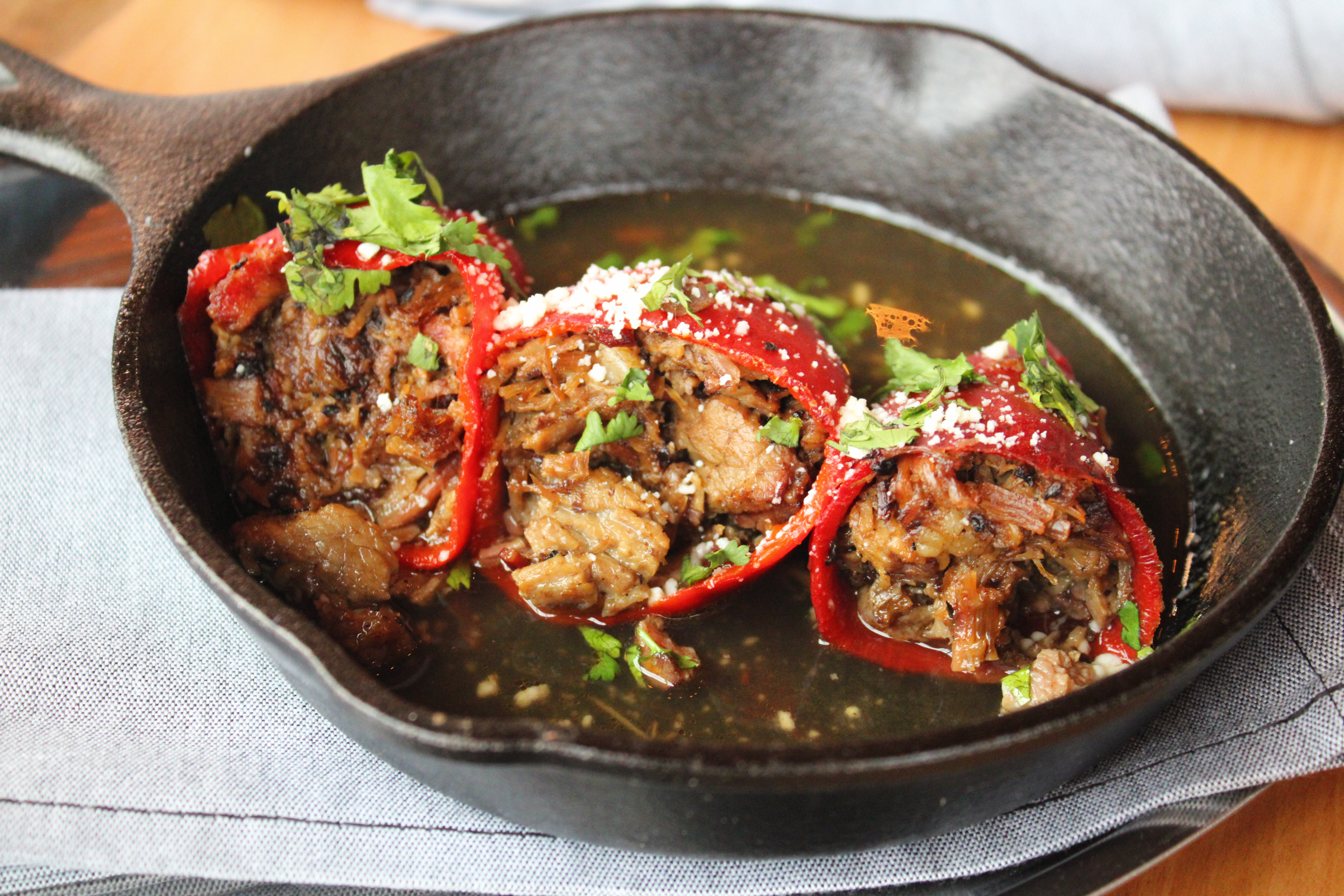 Barbecue stuffed peppers in a cast iron skillet