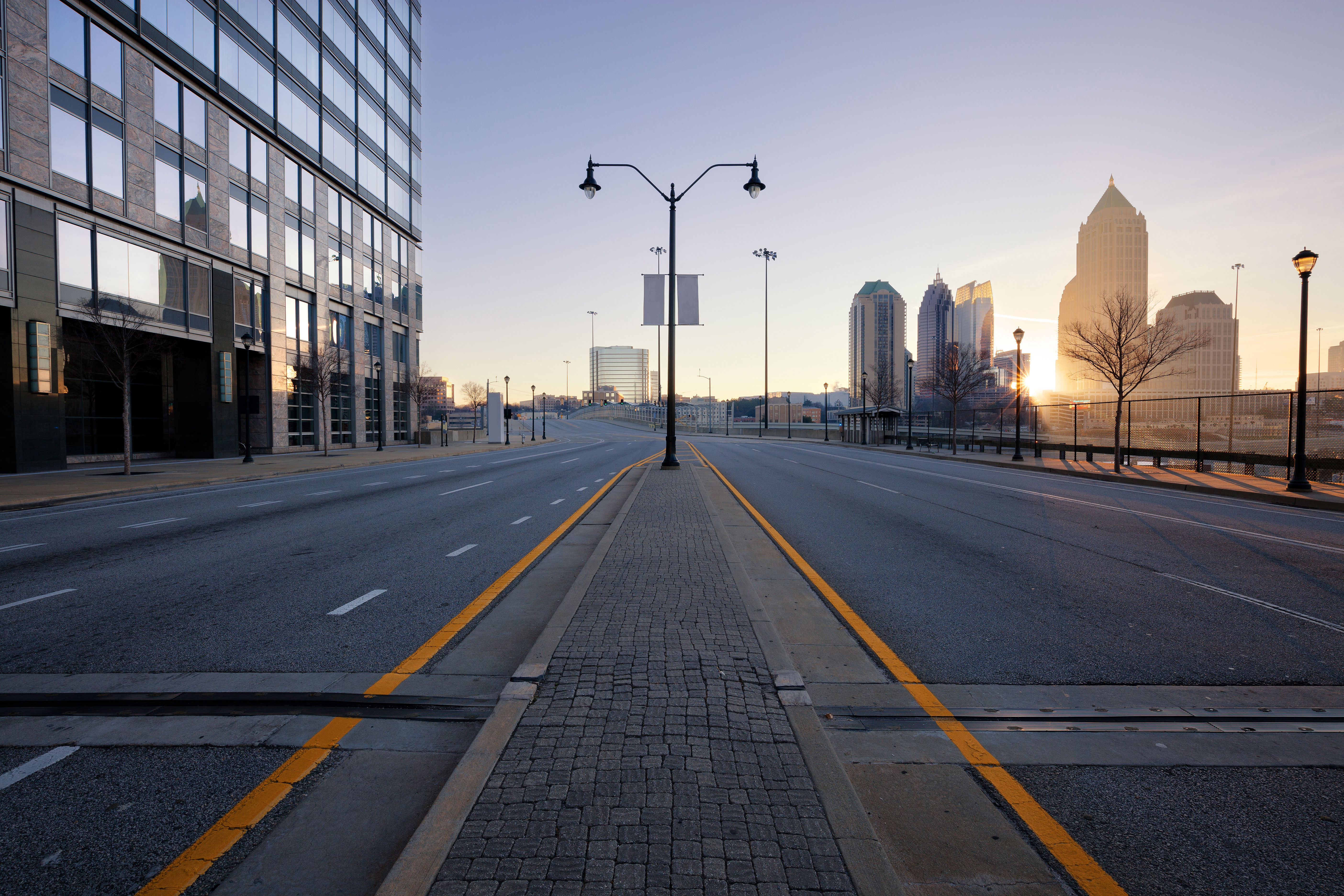 A photo of an empty Atlanta street with a Midtown skyline at right.