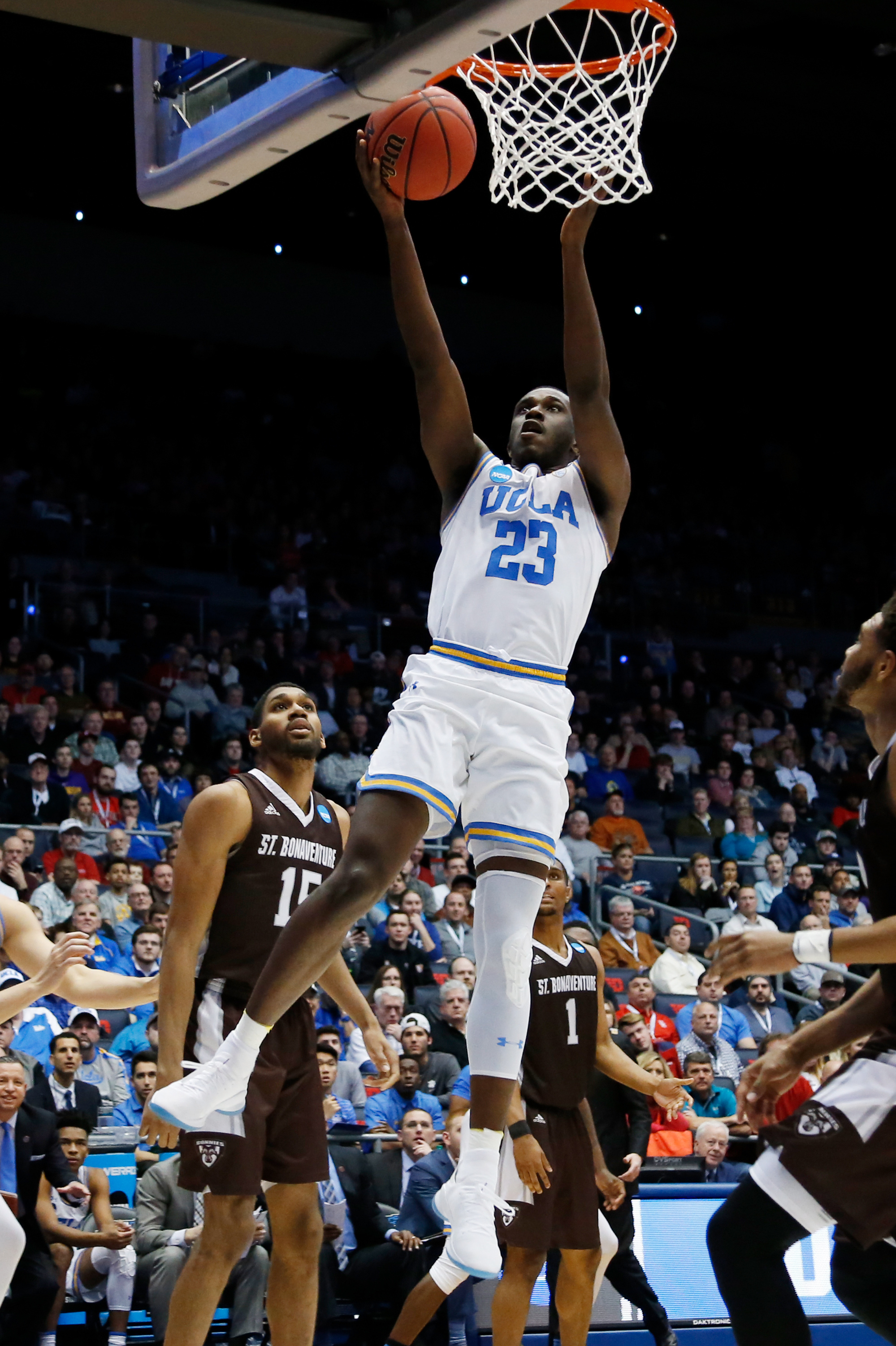 Prince Ali #23 of the UCLA Bruins attempts a lay up against the St. Bonaventure Bonnies