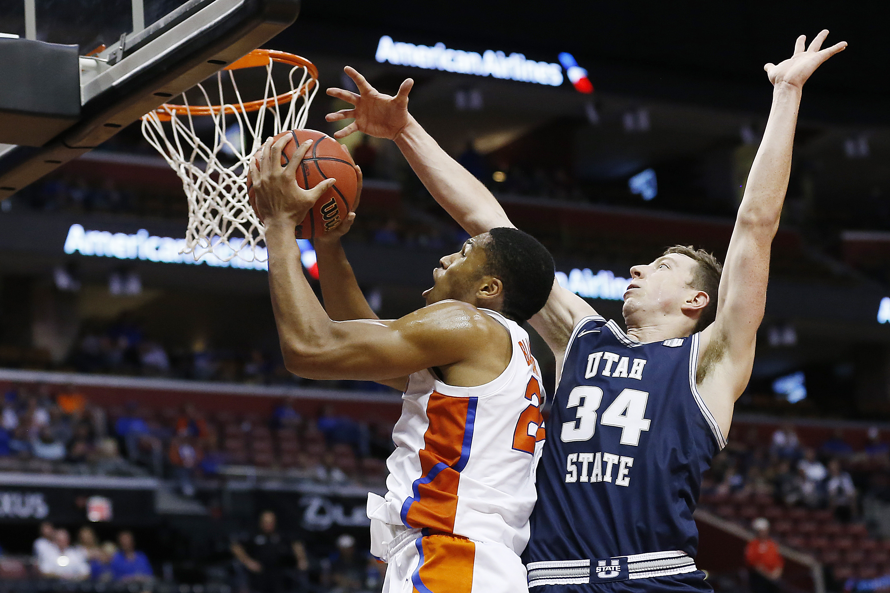 Kerry Blackshear Jr. of the Florida Gators shoots against Justin Bean of the Utah State Aggies during the second half of the Orange Bowl Basketball Classic at BB&T Center on December 21, 2019 in Sunrise, Florida.