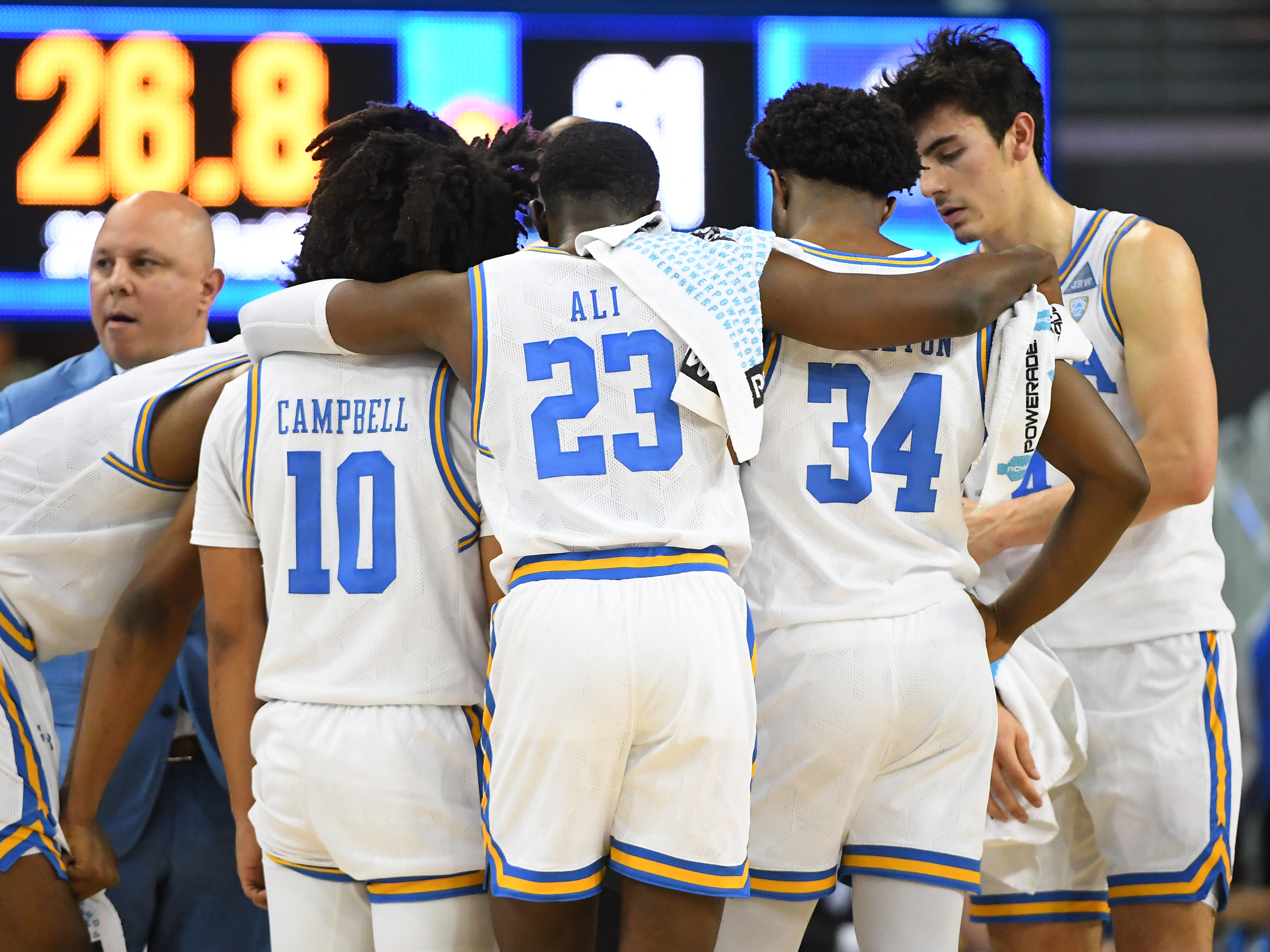 Chris Smith, Tyger Campbell, Prince Ali, David Singleton and Jaime Jaquez Jr. of the UCLA Bruins huddle during a time out during the game against the Colorado Buffaloes at Pauley Pavilion on January 30, 2020 in Los Angeles, California.
