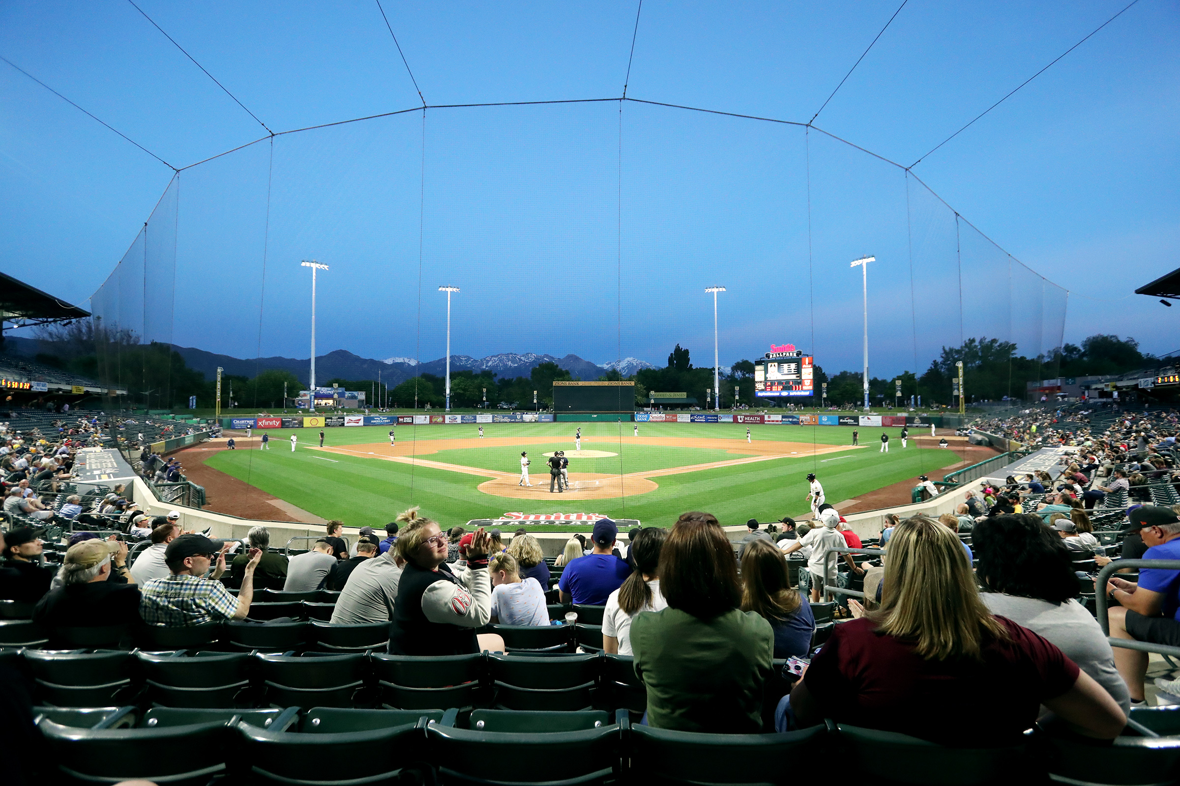 Protective netting helps to keep fans safe as they enjoy a Salt Lake Bees game at Smith's Ballpark in Salt Lake City on Wednesday, June 5, 2019.