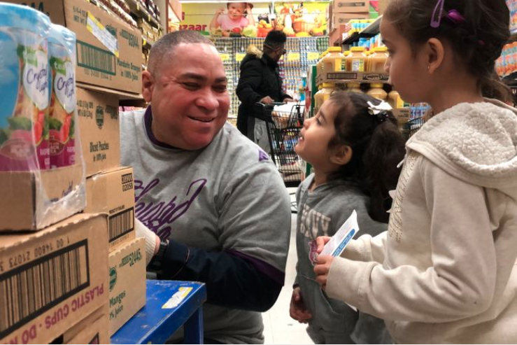 Cailynn, 3, and her big sister Chrystie, 5, ask a Food Bazaar worker for help with the scavenger hunt, Jan. 30, 2020.